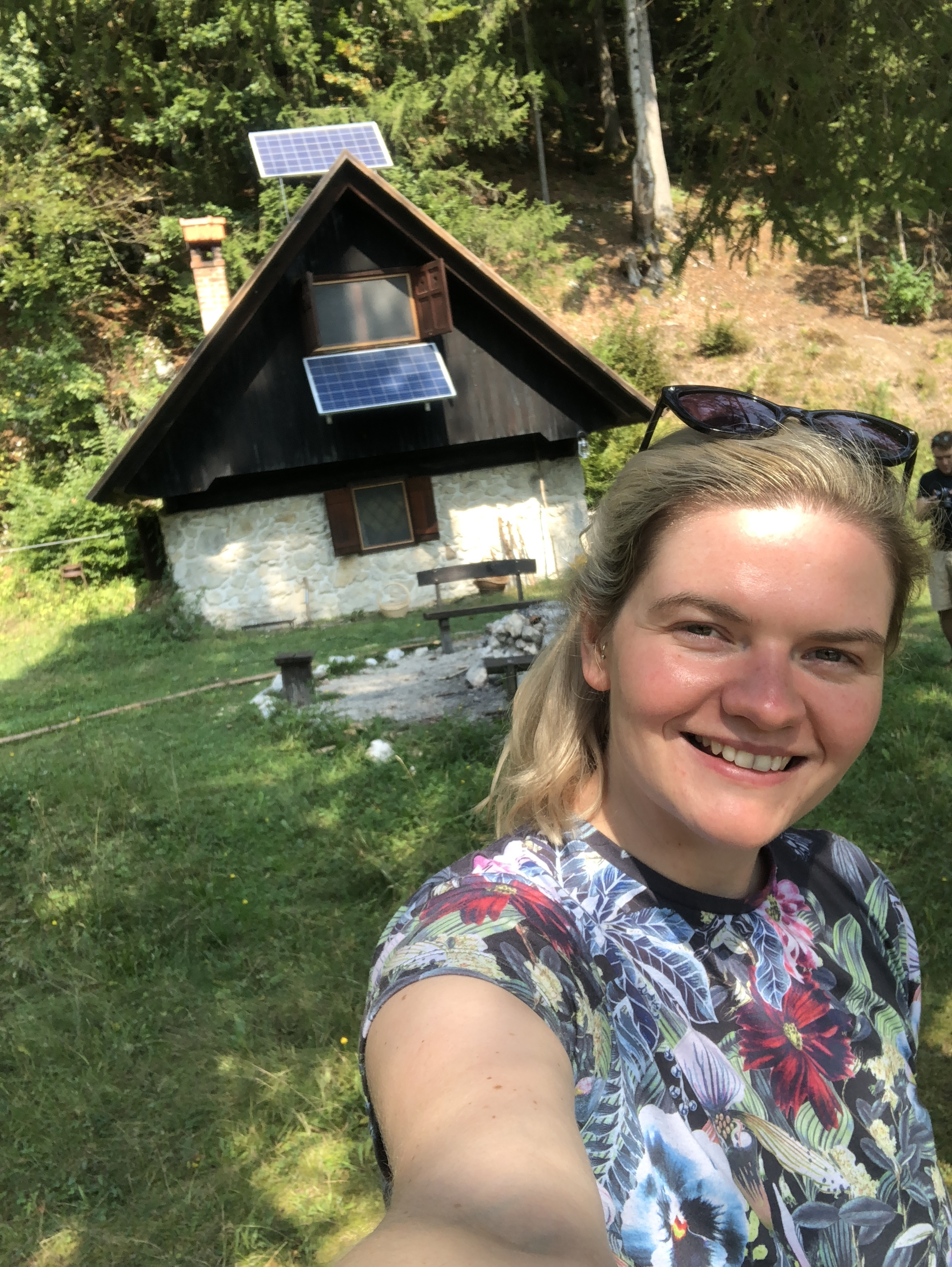 In front of our eco-hut in Slovenia with a very sunburnt face