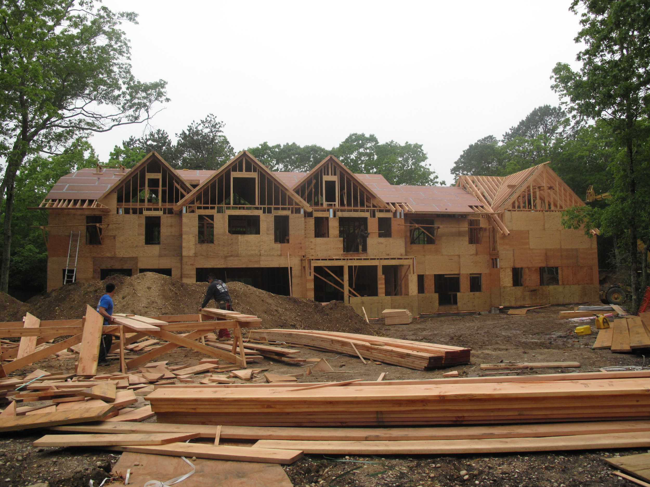 Roof going up on this Watermill residence. Seeing lots of progress very quickly.