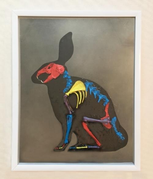 Rabbit, 2017.  Bones, tar, oil paint, glass mirror.
