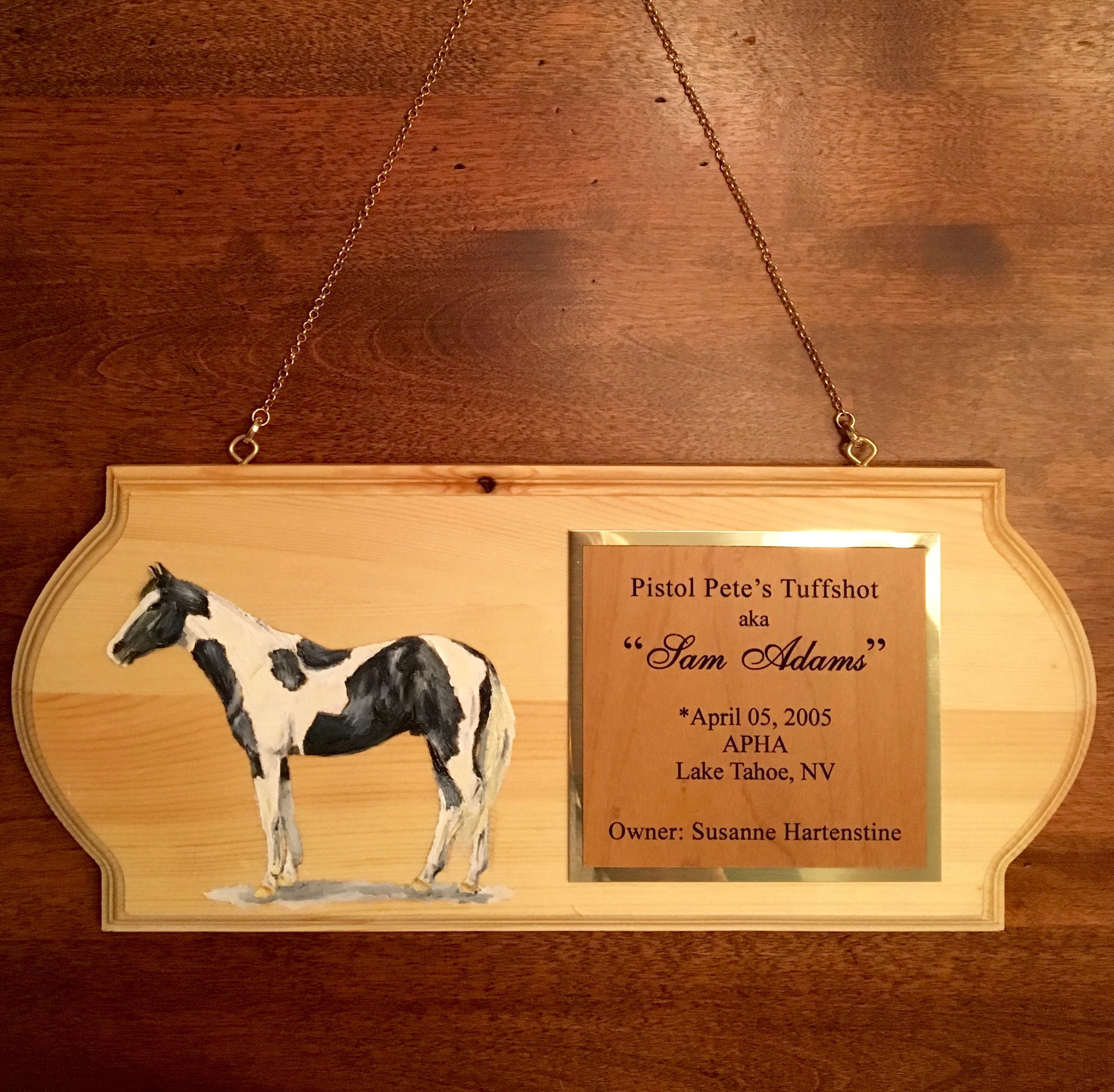 the medium Pine Plaque is a more rustic option. The name plaque is also a brass/wood combination.
