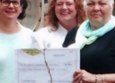 Kim Patterson and Brandi Phillips present, President and CEO, Shirl Regan $6,200!