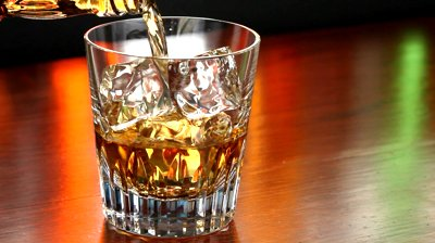 stock-footage-pouring-a-scotch-whiskey-on-the-rocks.jpg