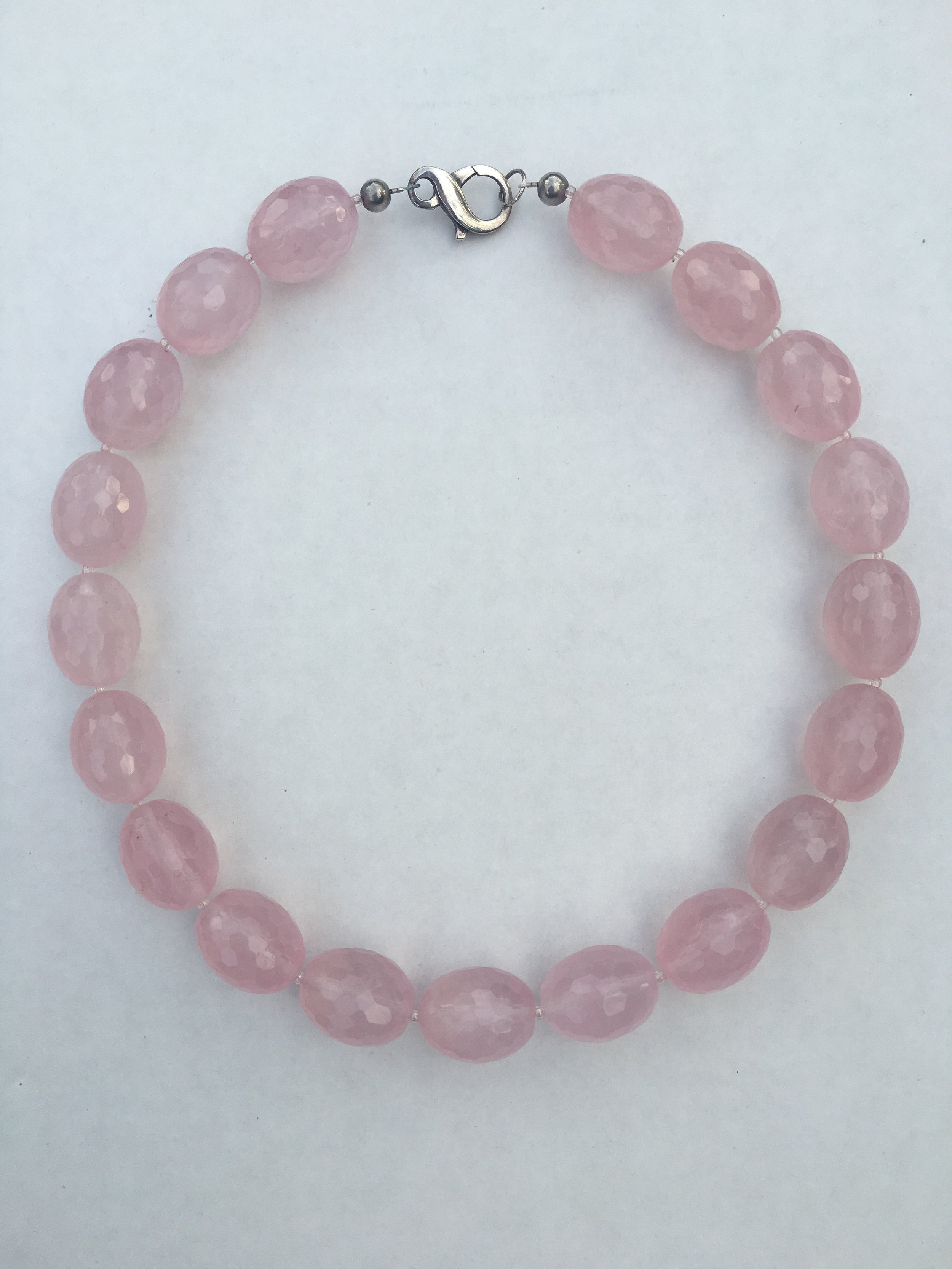 rose QUARTZ NECKLACE   Faceted oval rose quartz beaded necklace.  Stainless steel clasp.