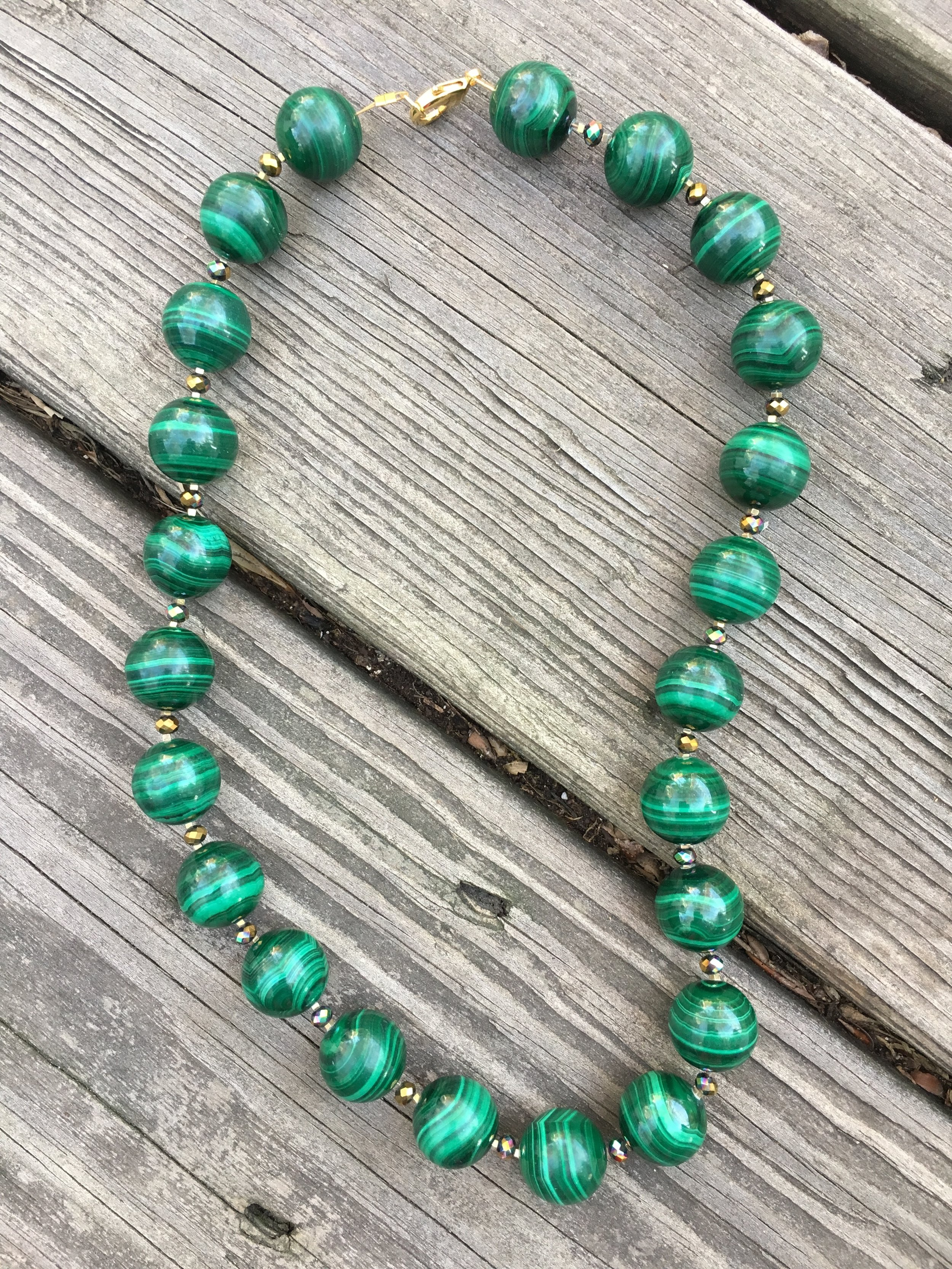 malachitE NECKLACE   Malachite necklace with glass beads and gold filled clasp.  $800