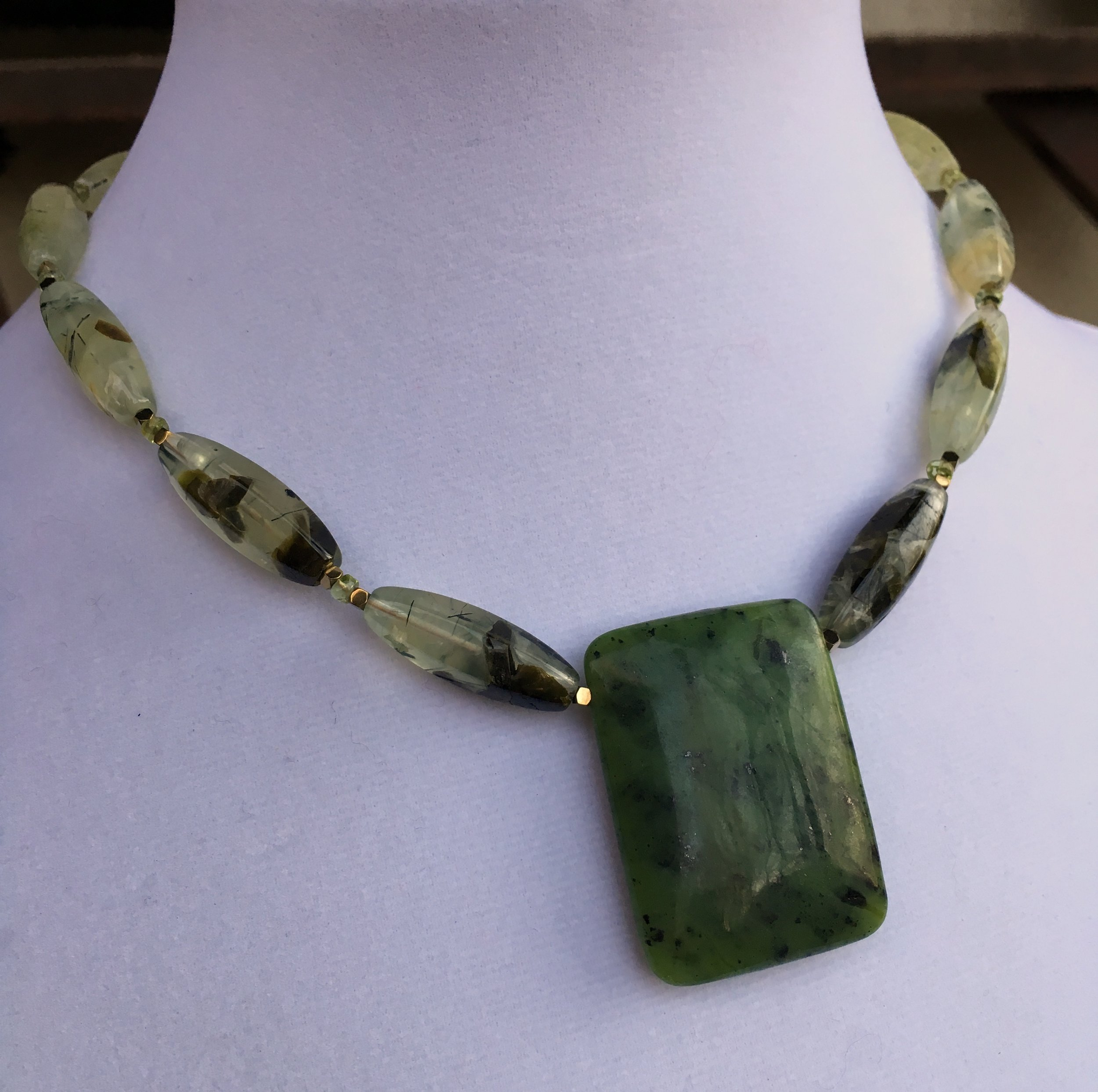 Jade pendant  30 x 40 mm Nephrite Jade Pendant. 26 x 8 mm prehnite fluted beads. Gold filled clasp. 17 in.$180