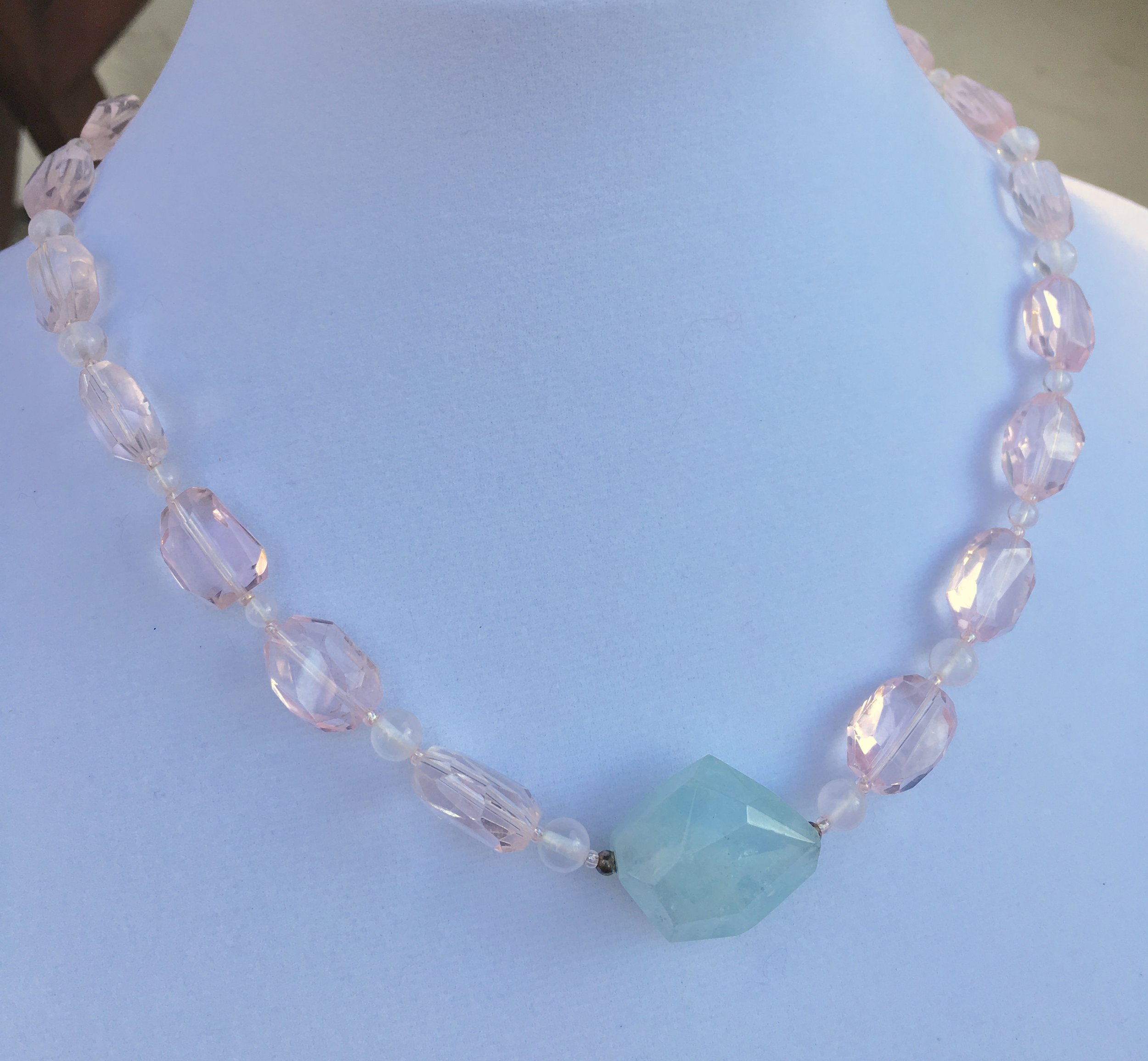 Aquamarine & Rose Quartz Pendant  23 x 25 mm chunky faceted center aquamarine stone,16 x 12 mm faceted Rose Quartz beads, round Rose Quartz beads. Sterling silver clasp. 19 in. $225