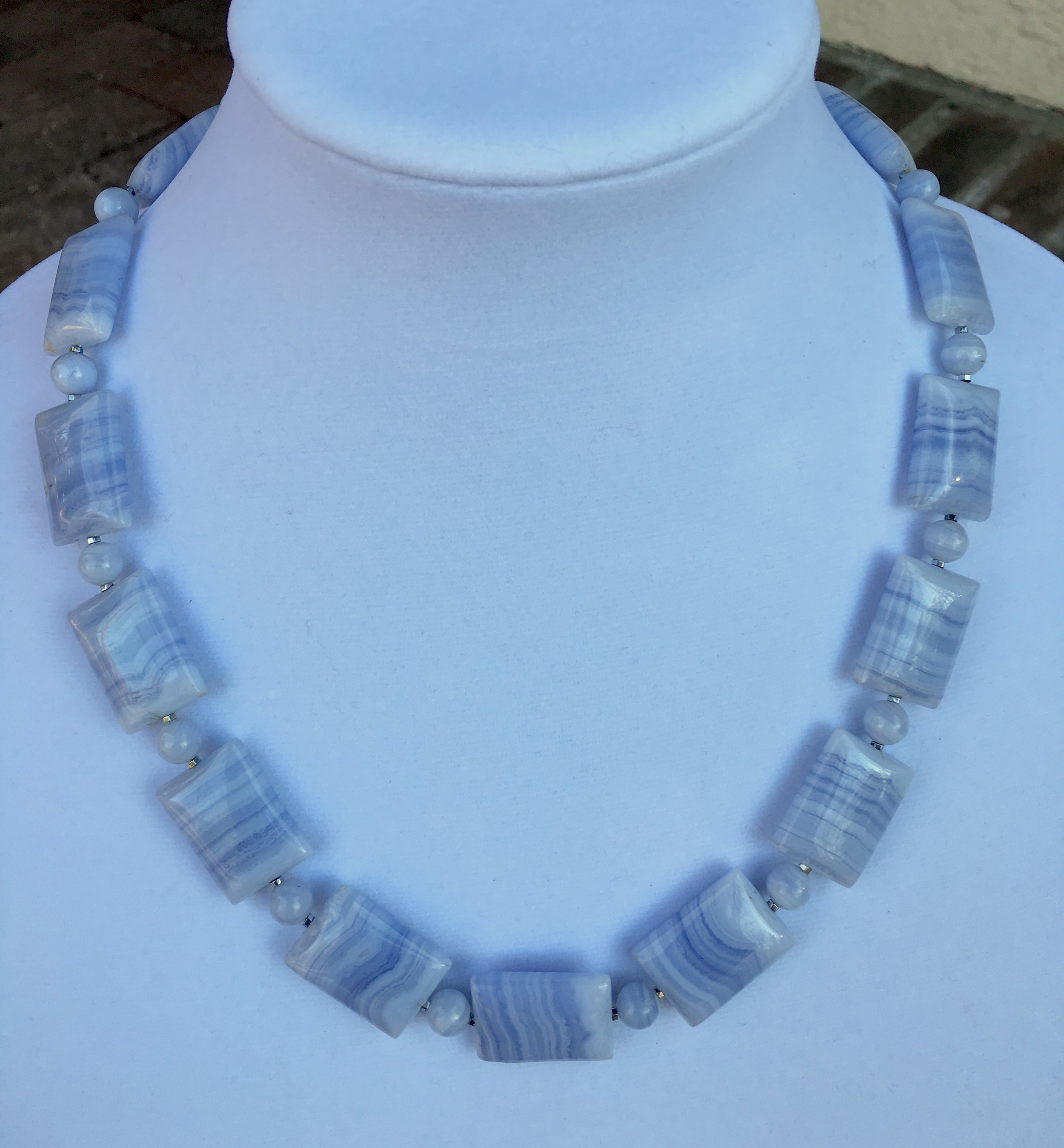 blue lace agate NECKLACE  18 x 26 mm rectangular blue lace agate beads with very delicate lines.Very fine. 8 mm round blue lace agate beads. Price has jumped for blue lace agate and I can't find this nice quality anymore. Sterling silver clasp.21 in. $350