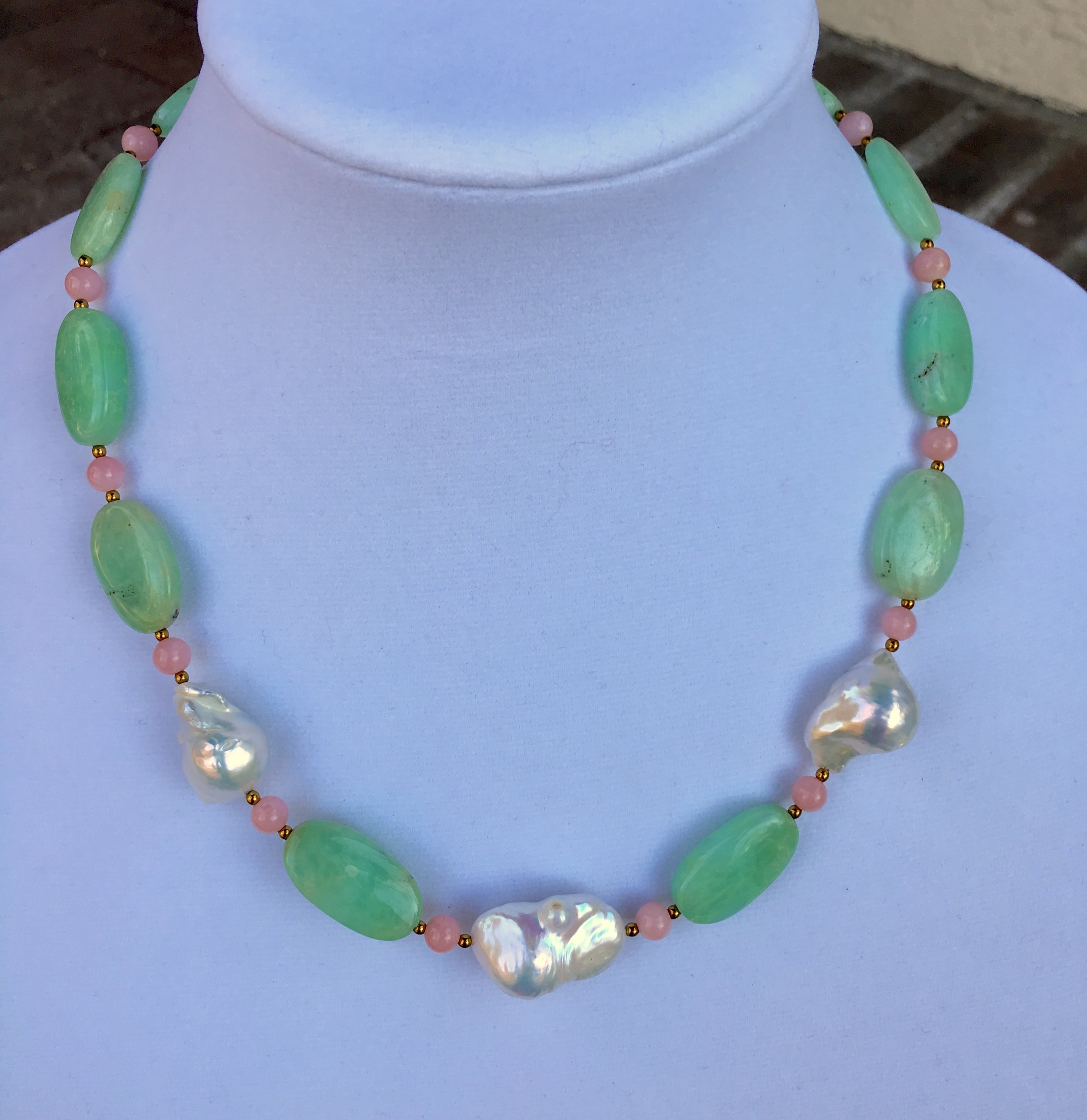 baroque pearl, chrysoprase & pink opal NECKLACE  Natural baroque pearl, the last of their kind.Center pearl is approx 26 x 17 mm. Graduated, intense color chrysoprase. Intense color 6mm pink opal beads. 20 in.$575