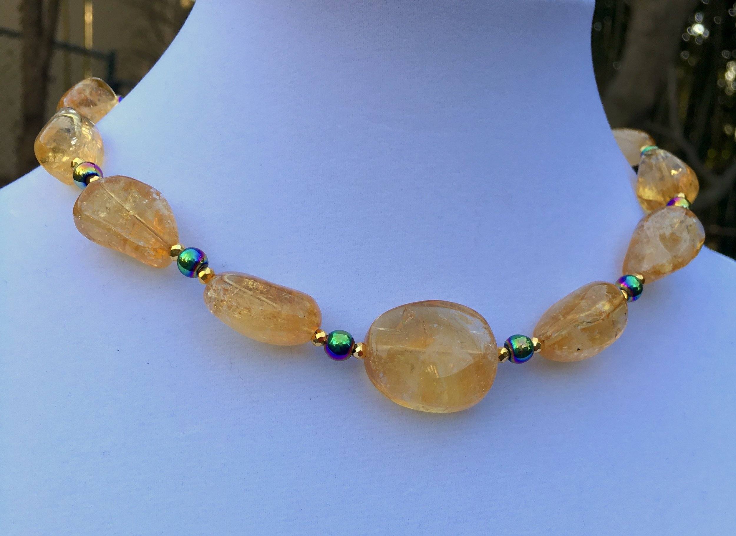 Citrine choker  Center citrine bead is 26 x 20mm. Nuggets are approx 24 x 15mm. Metallic round beads, gold filled clasp. 18 in. $500