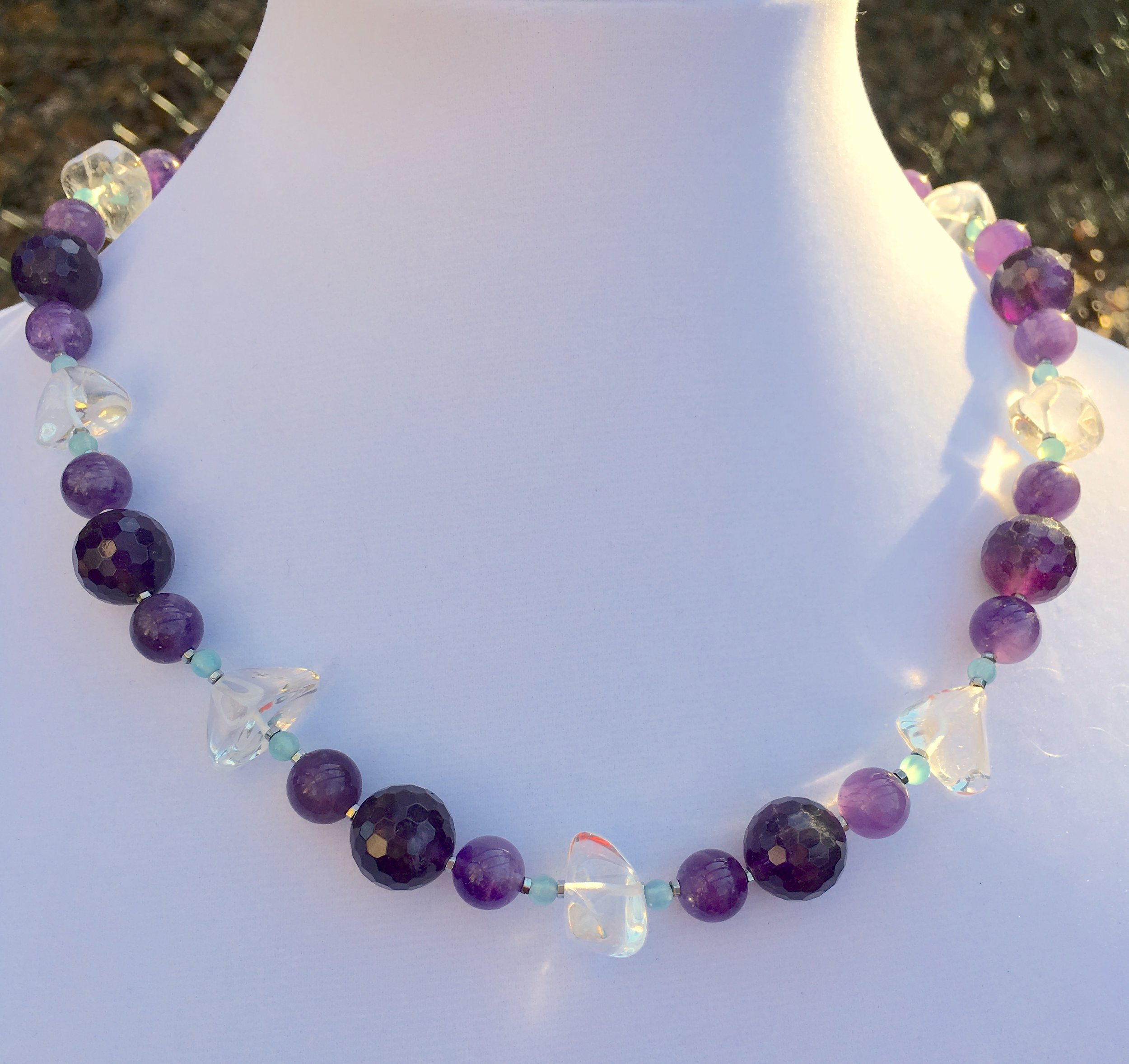 amethyst, clear quartz & aqua agatE NECKLACE  Large faceted 14 mm amethyst beads.10 mm medium purple amethyst beads. Clear quartz nuggets.Dyed aqua agate small beads.Sterling silver clasp. 21 in.$275