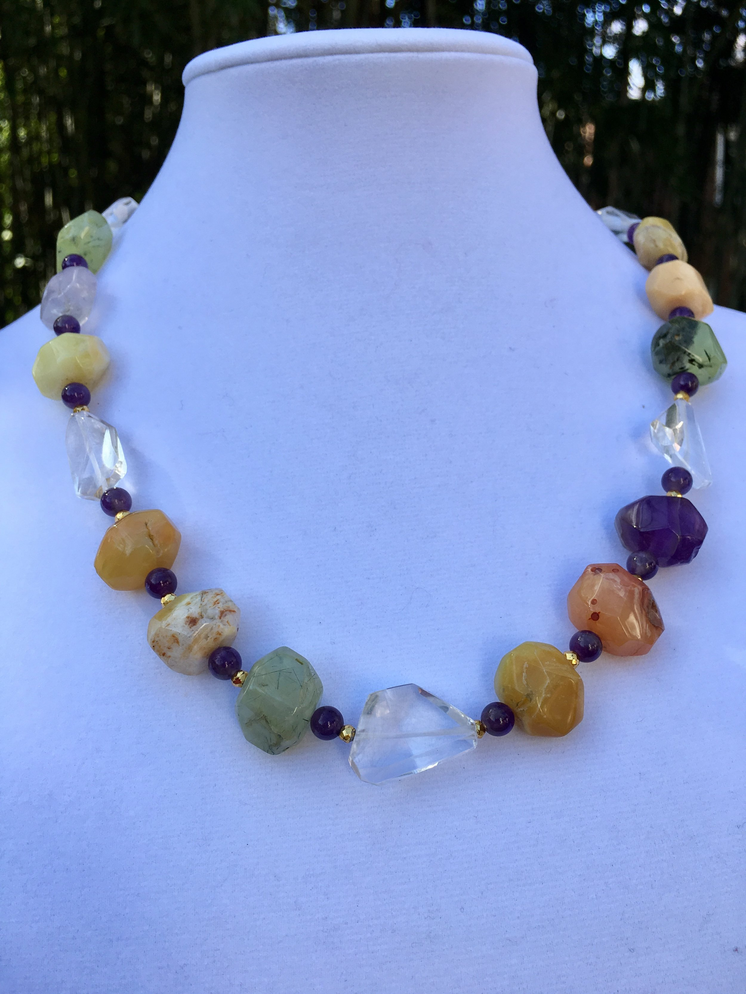 multi semiprecious stone NECKLACE with Faceted clear quartz & amethyst  Multi stone necklace of chunky faceted 15 x 29 mm beads including amethyst, carnelian, prehnite, agate and yellow jade. Round amethyst beads, faceted clear Quartz, gold filled clasp. 22 in. $225