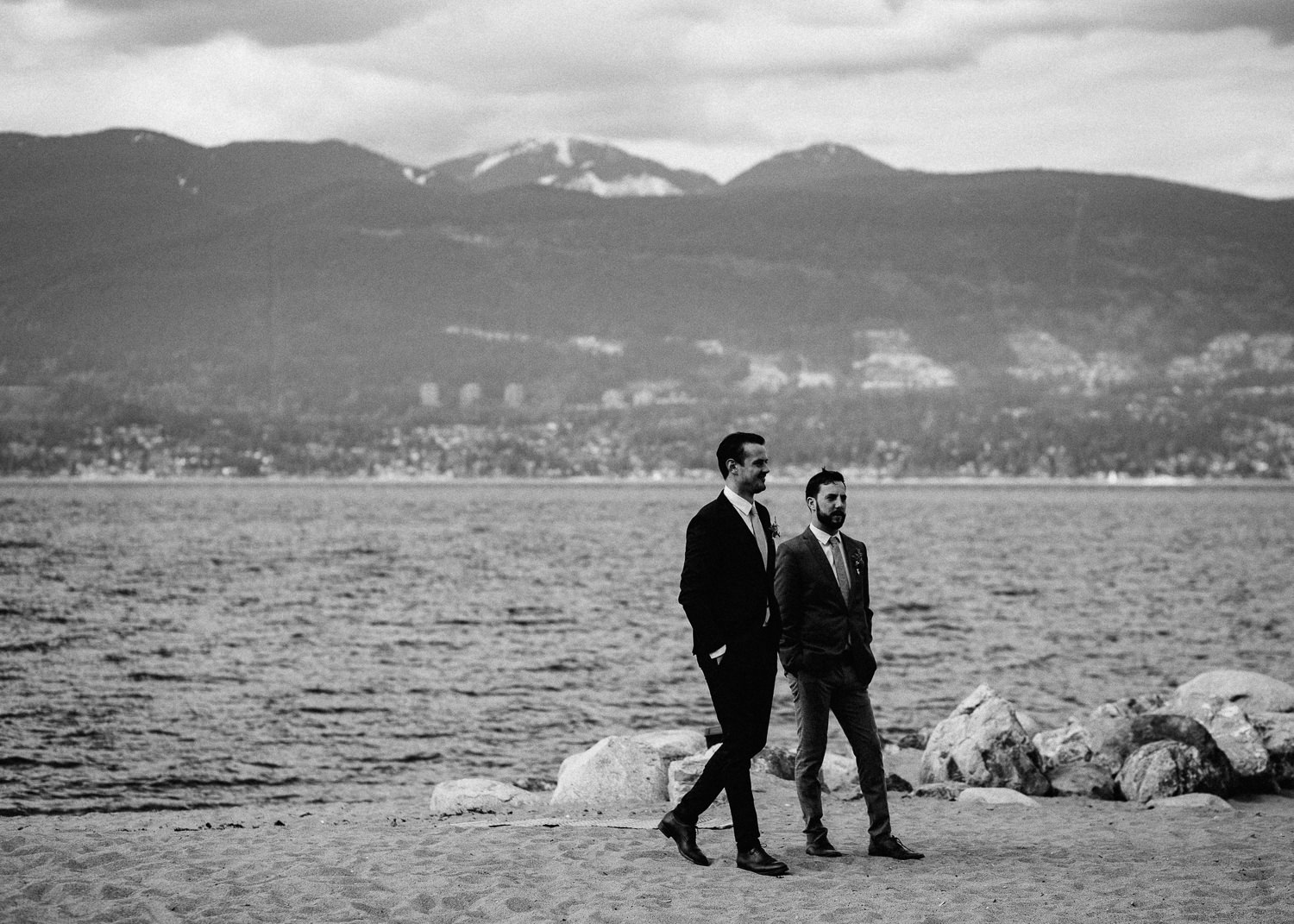 groom and best man waiting on beach in vancouver