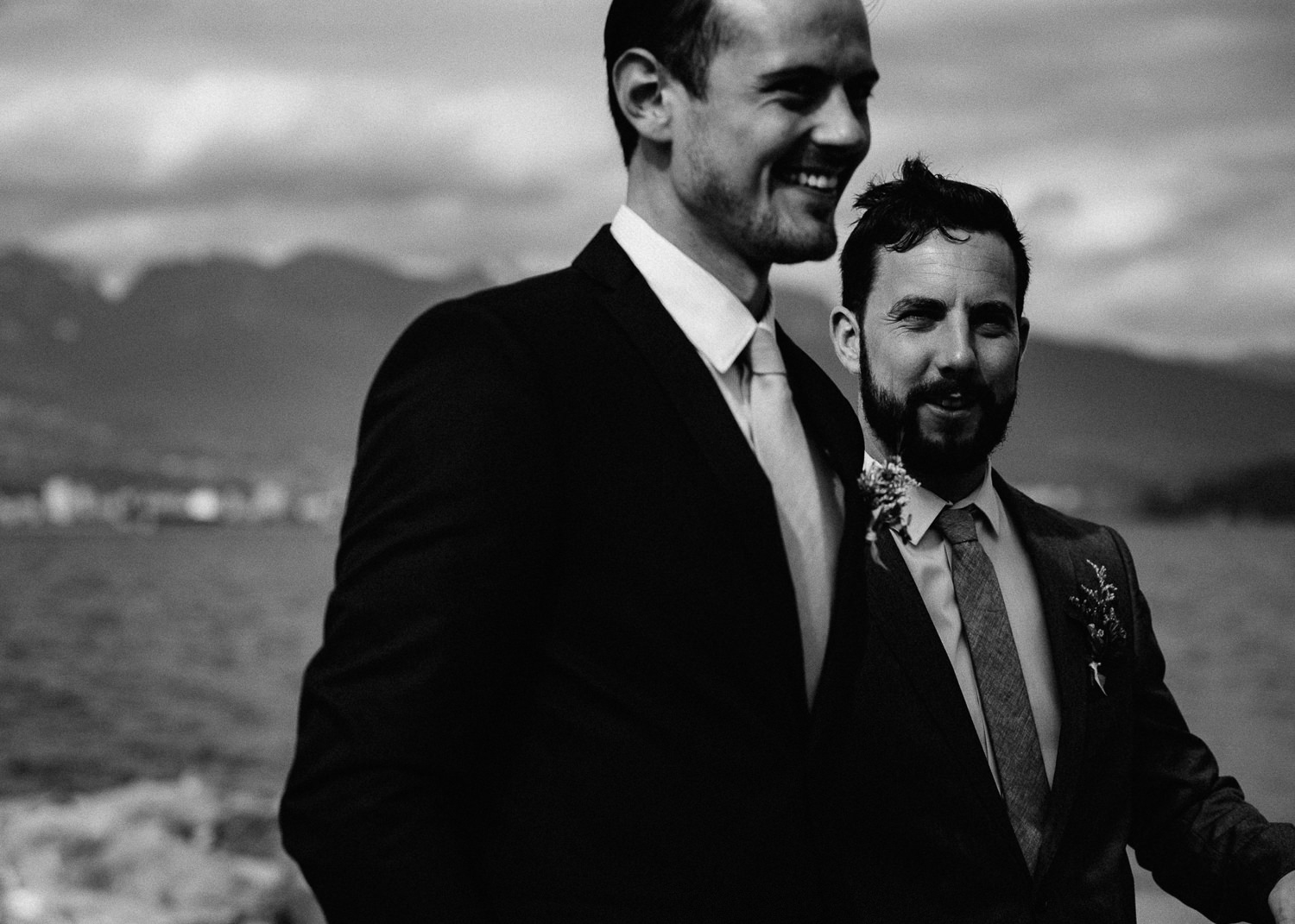 groom laughing with his best man