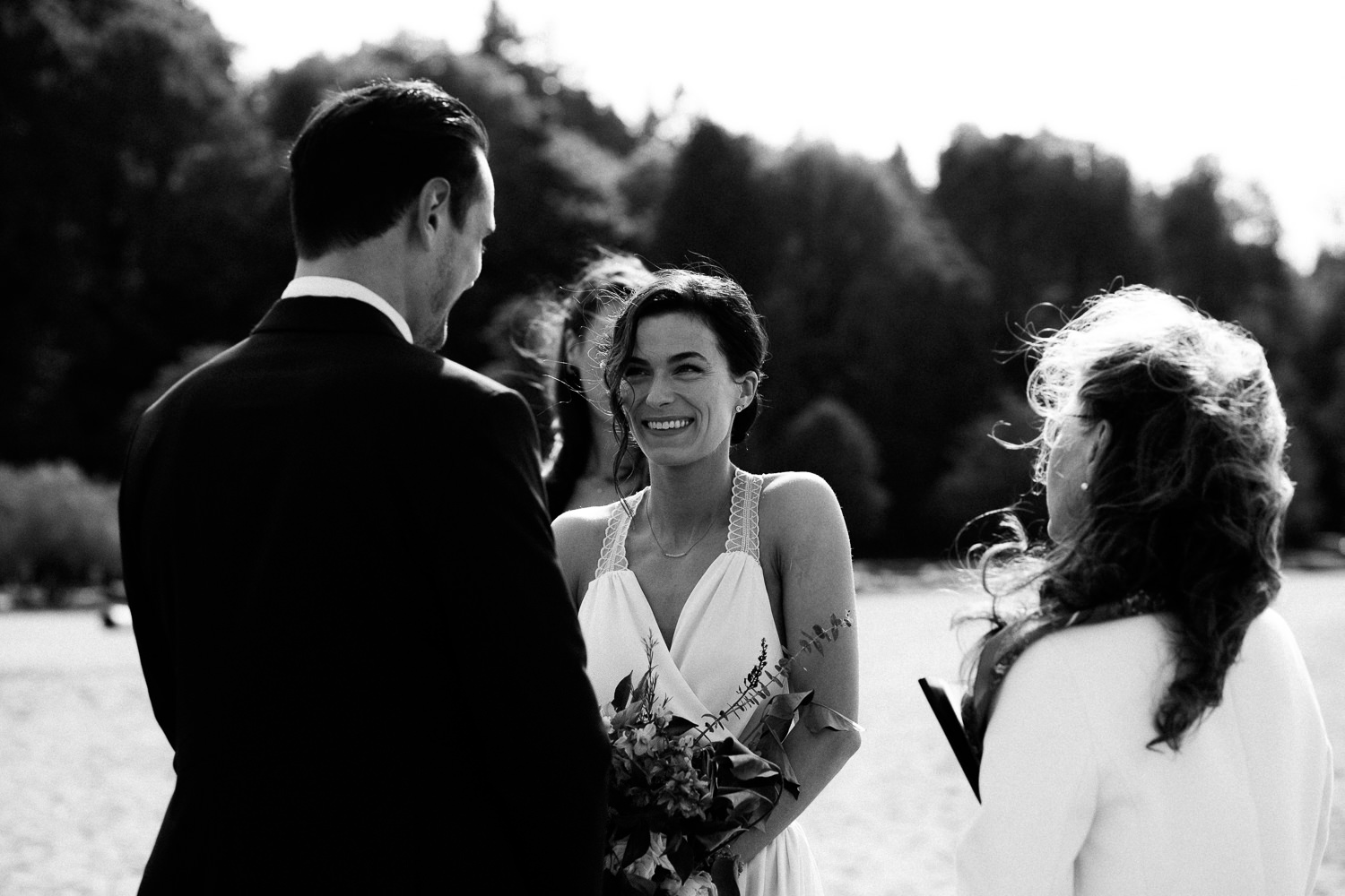 bride smiling at the groom during the ceremony