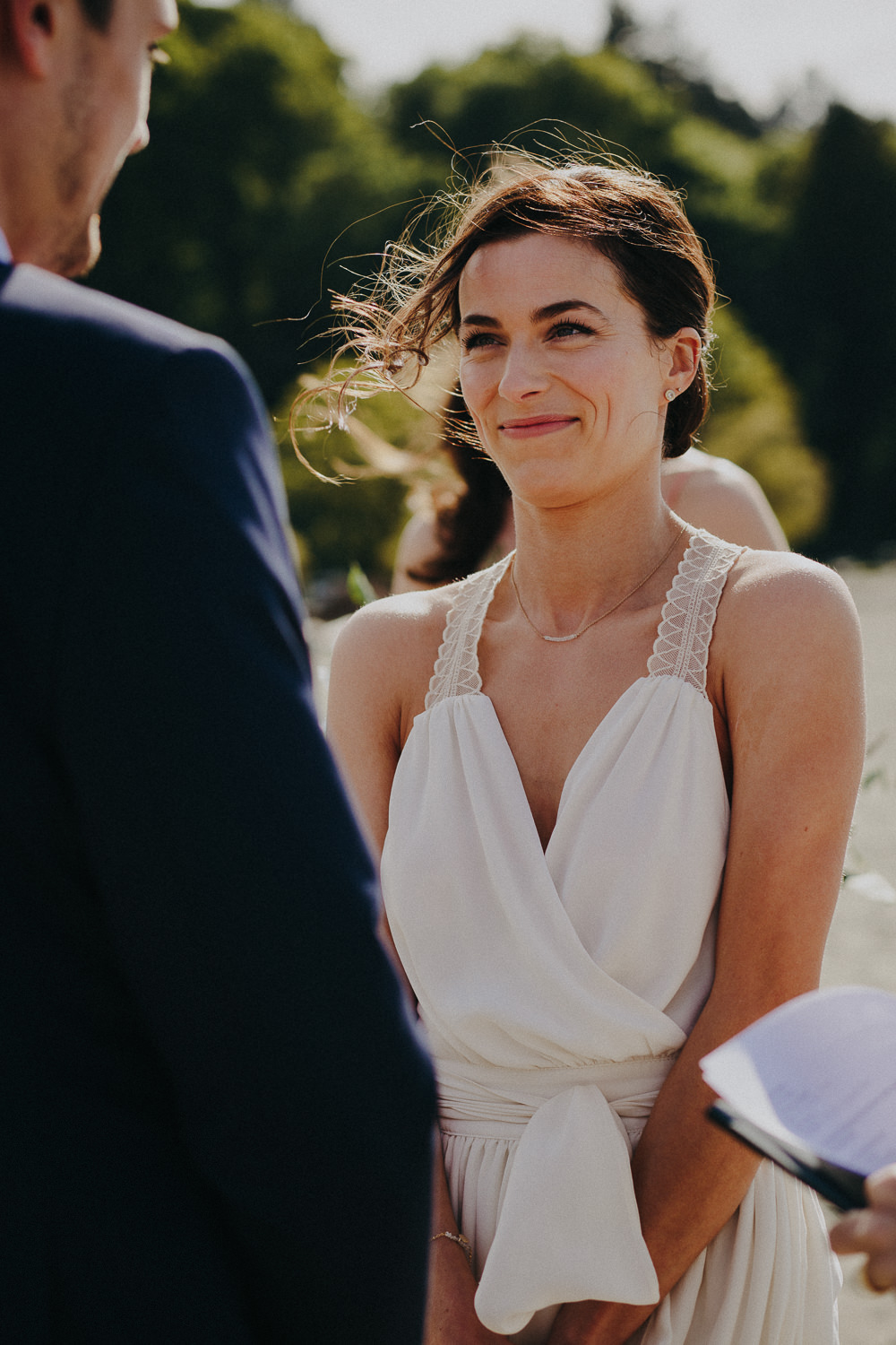 the bride smiling at the groom