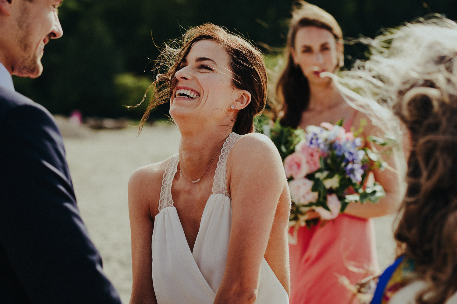 laughing bride during the beach ceremony