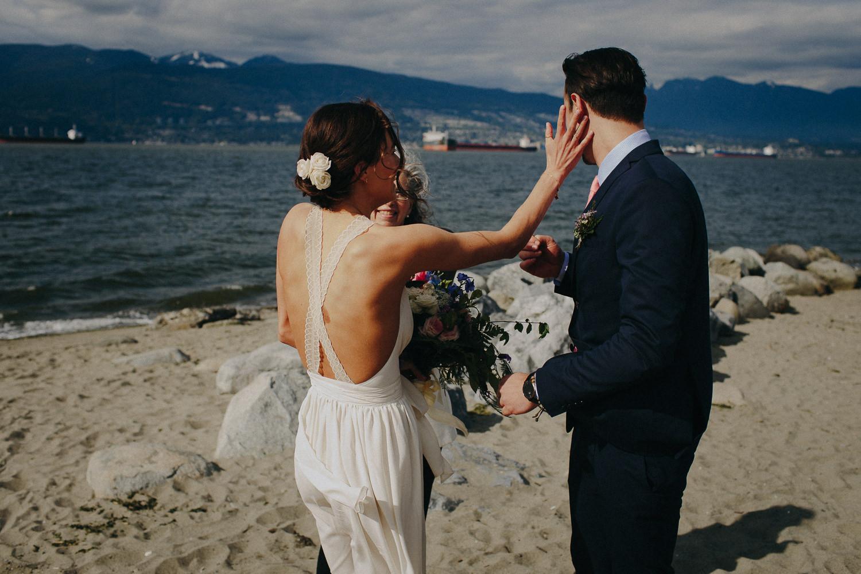 bride wiping away the groom's tear