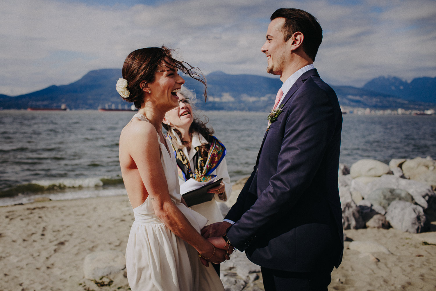 laughing couple getting married in vancouver