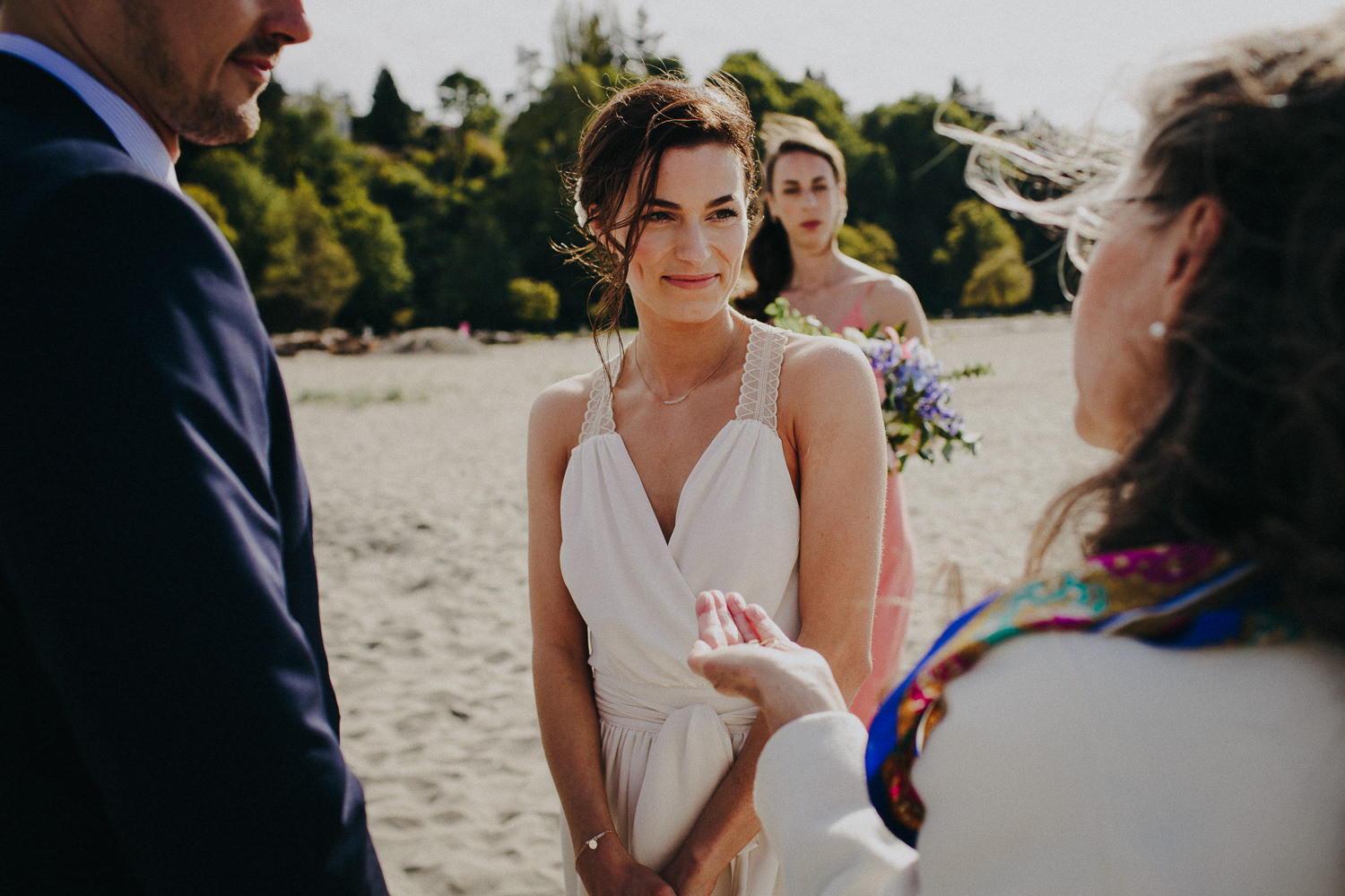 the bride looking at the officiant