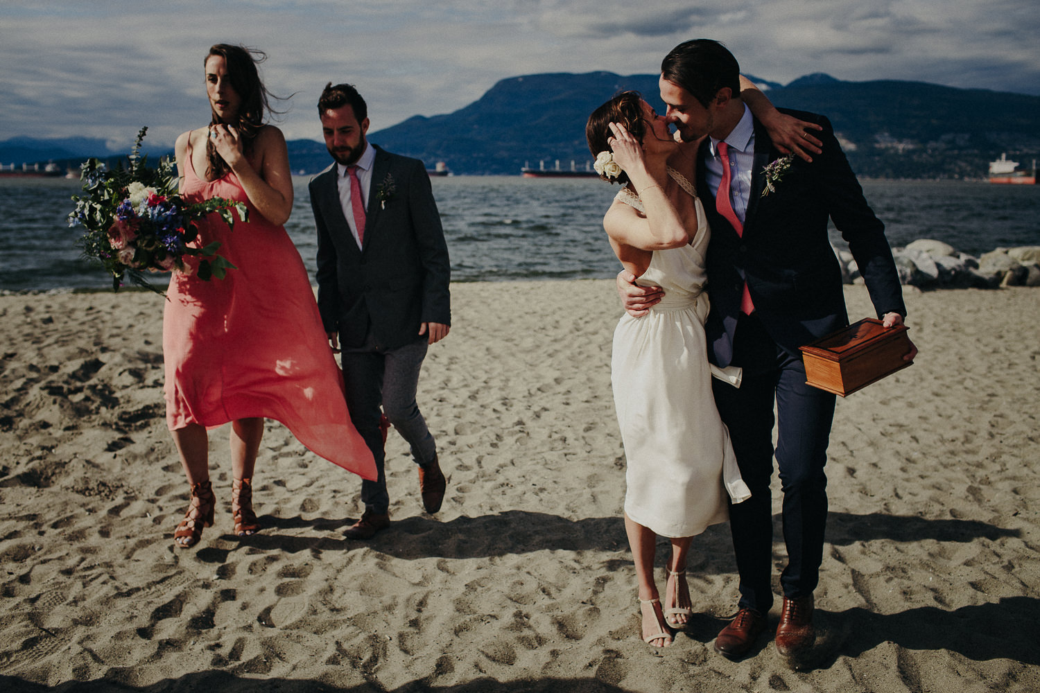 kissing bride and groom on the beach