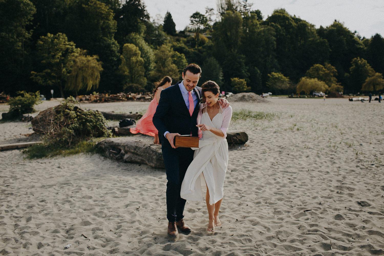 bride and groom walking on jericho beach