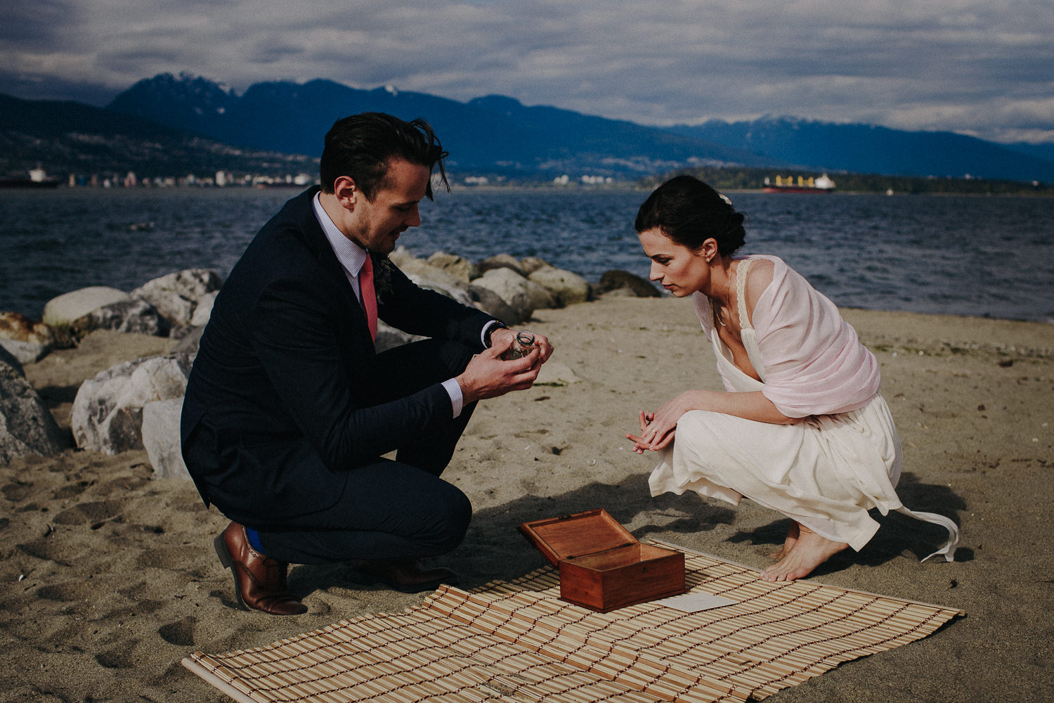 bride and groom collecting sand from their ceremony site