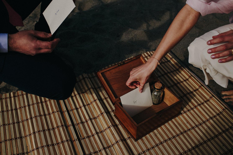 bride putting a love note in a box