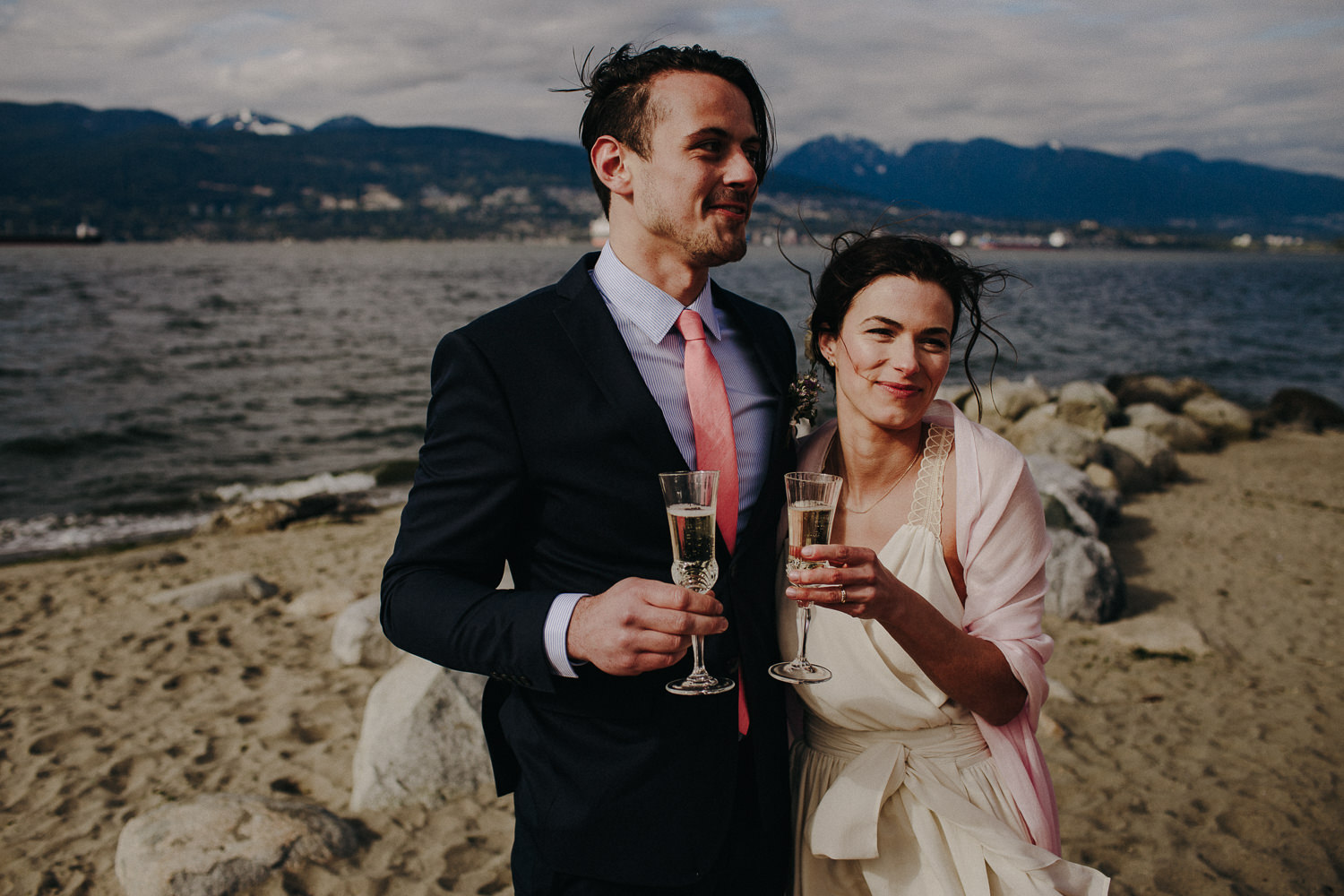 the bride and groom enjoying champagne