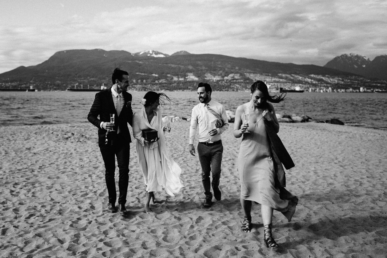 wedding party walking on the beach