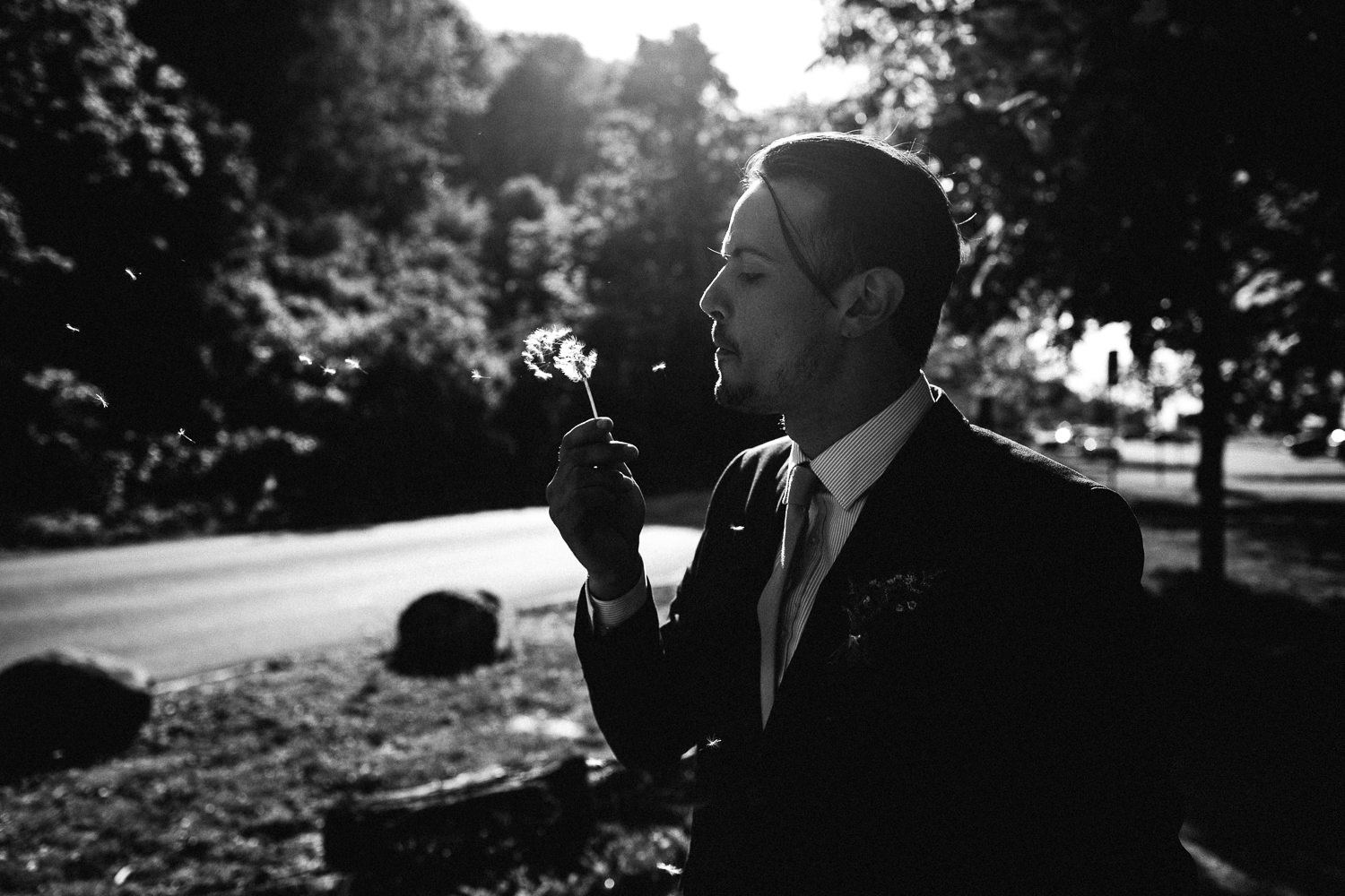groom with a dandelion