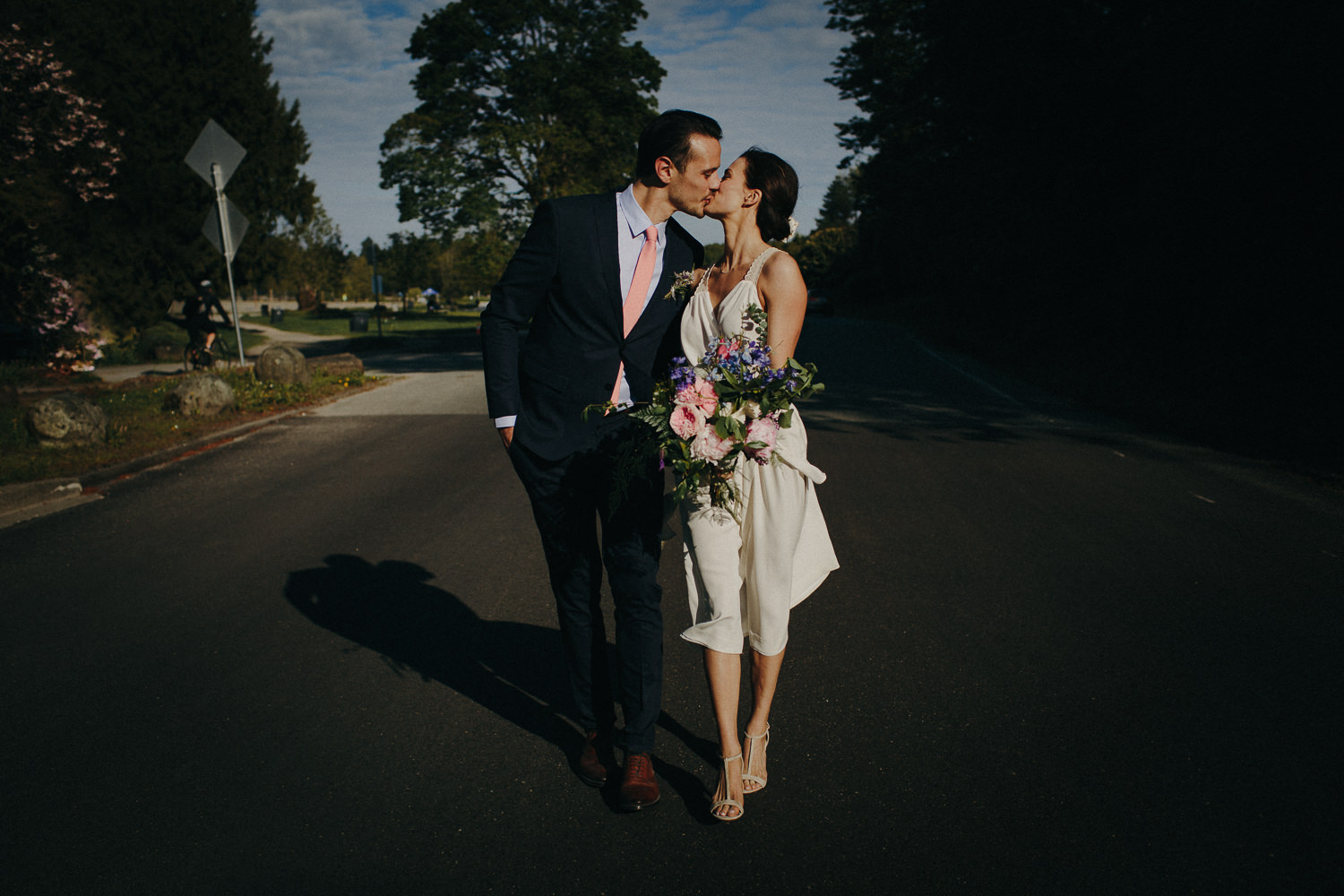 bride and groom kiss while walking