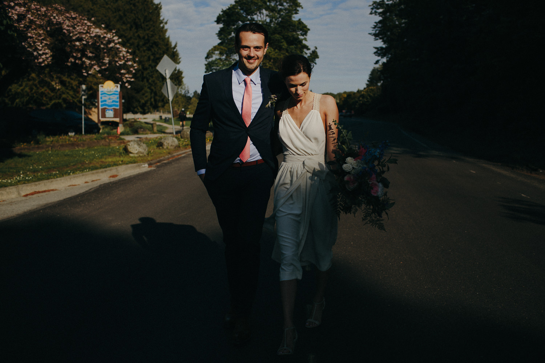 newlyweds walking towards the sun