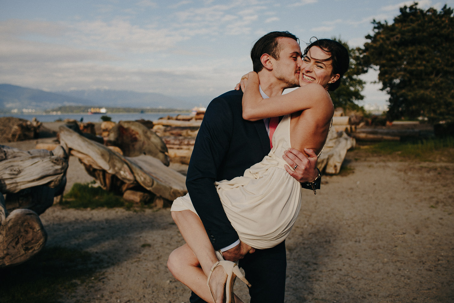 groom kissing the bride on the cheek