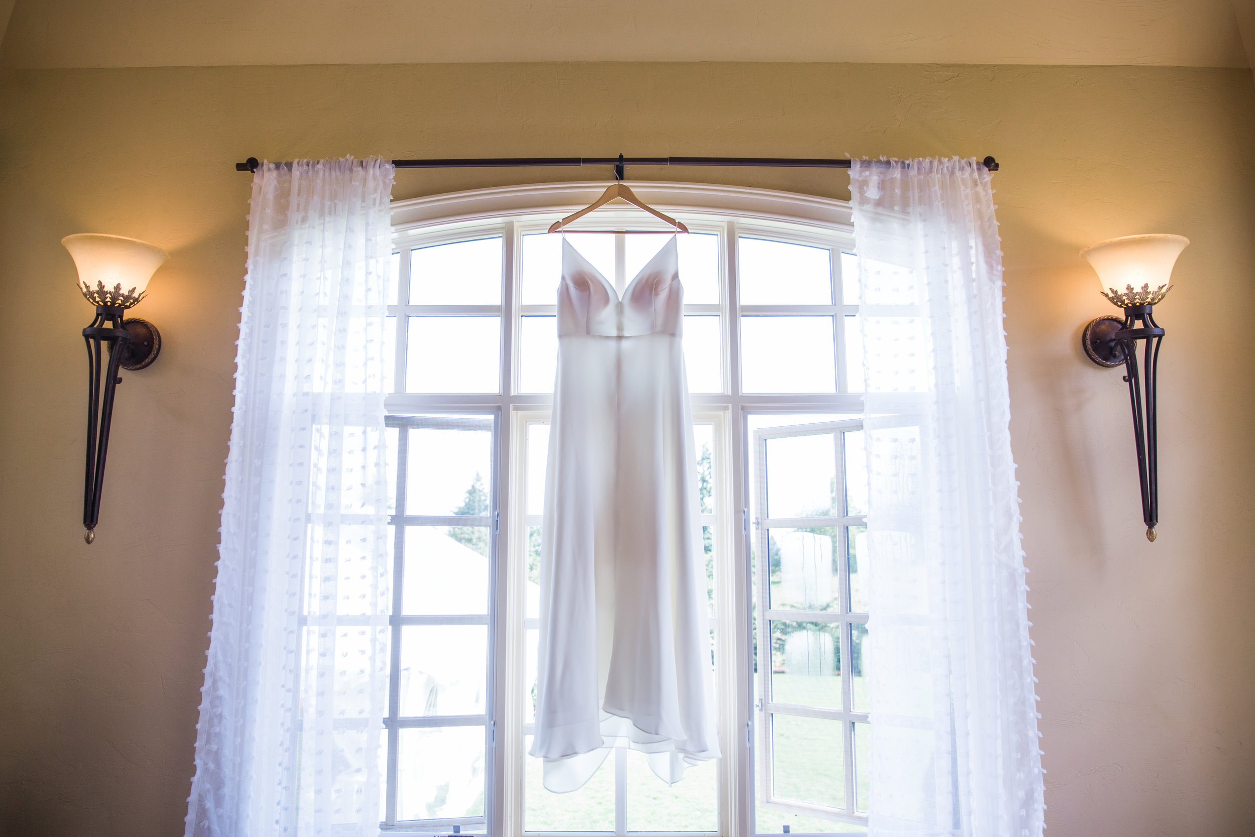 hanging wedding dress photo