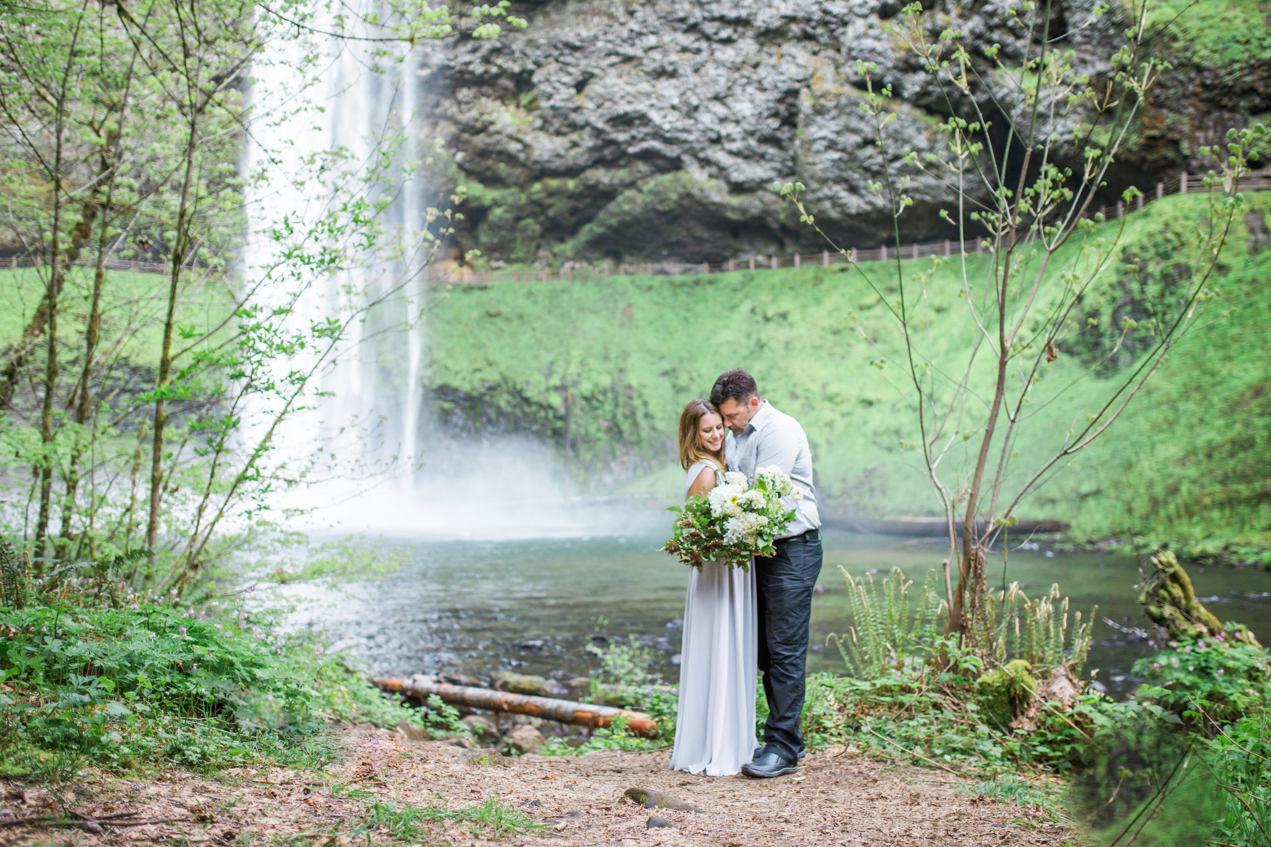 This sweet moment under this waterfall