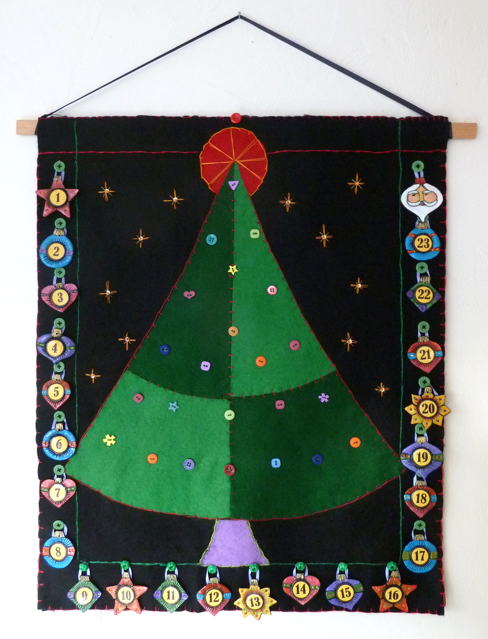Ornaments hang around the outside to make a border.