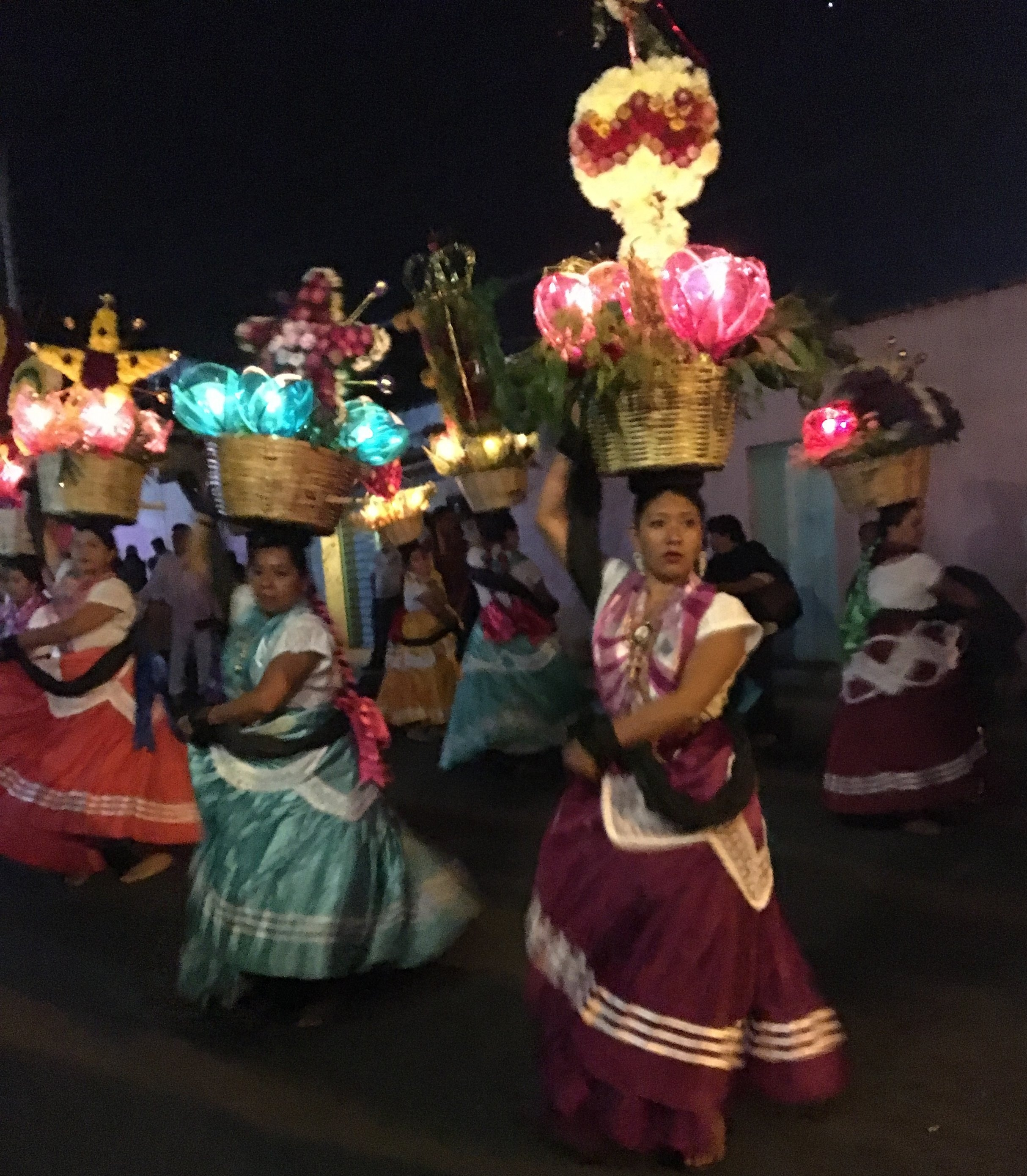 Beautiful dancing girls are in all the parades. This was a night parade so their baskets were lit.