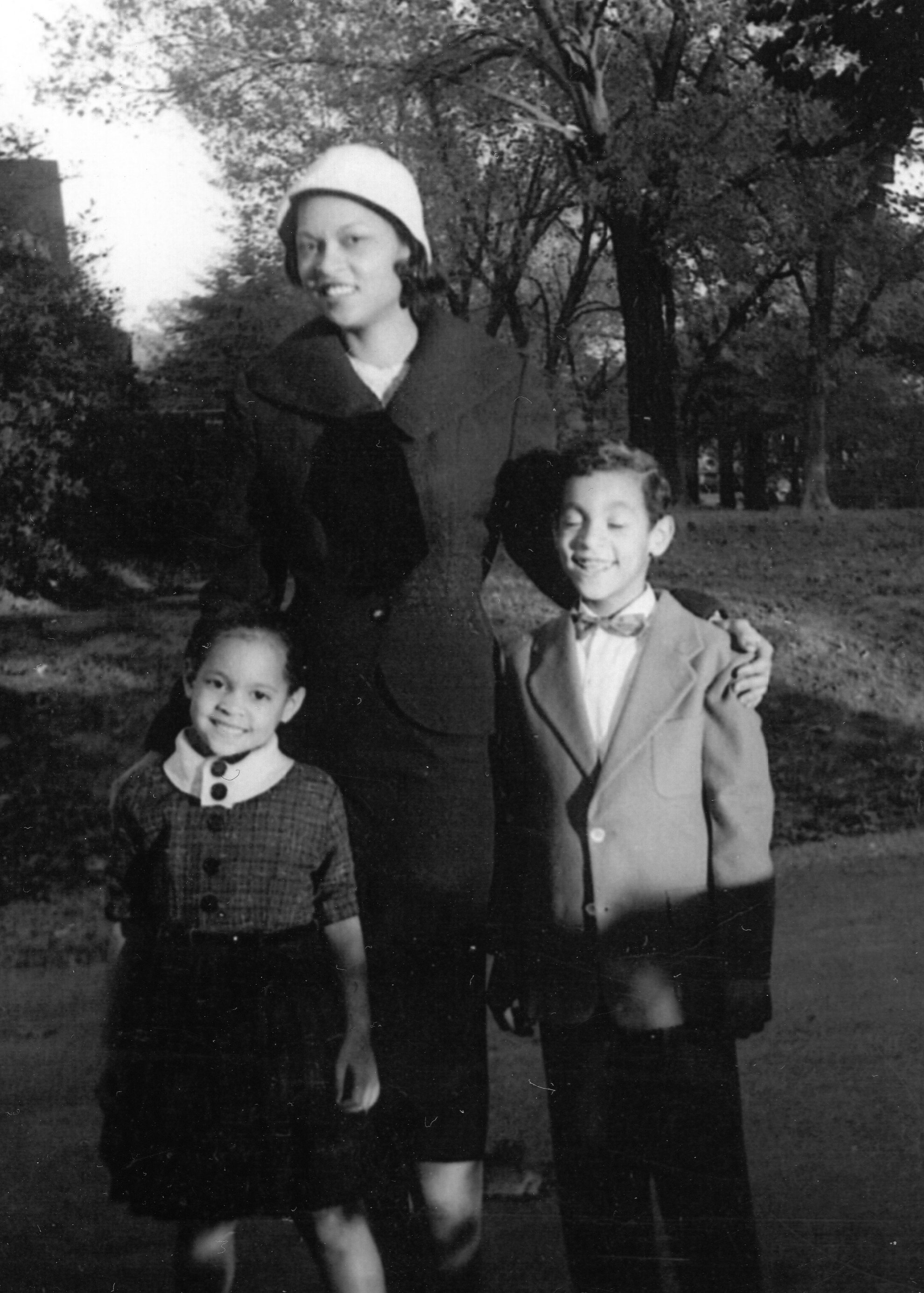 Left to right:  Erica's mother, grandmother, and uncle in the front yard of their home on Parkway, circa mid-1950's.