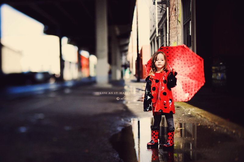 ew9-girl-in-raincoat-and-rain-boots.jpg