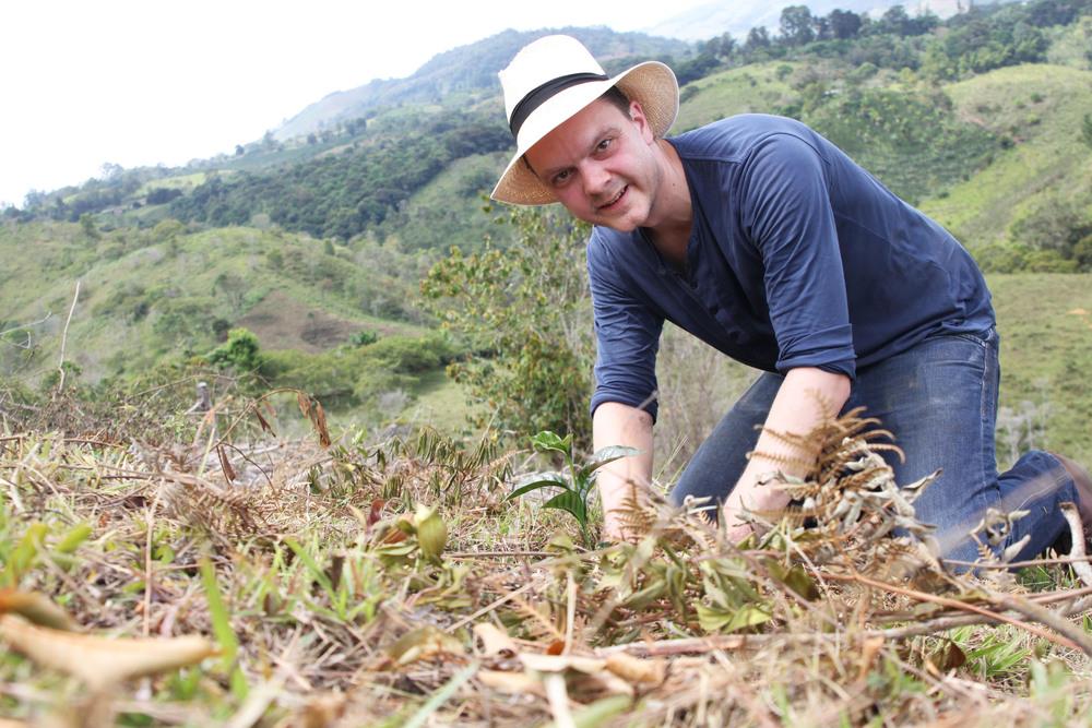 Happy+farmer+planting+Typica+in+February+2015.jpg