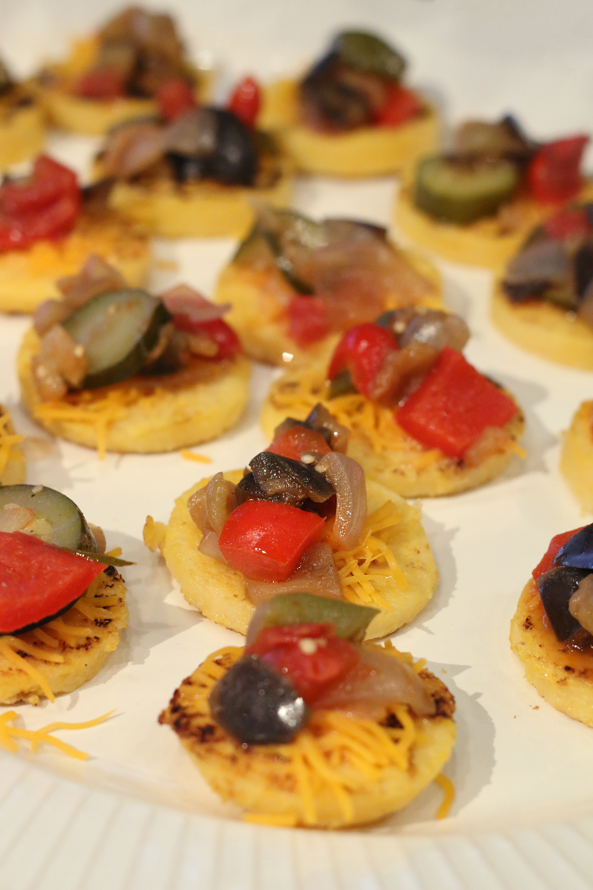 Cheddar Polenta Cakes topped with Ratatouille