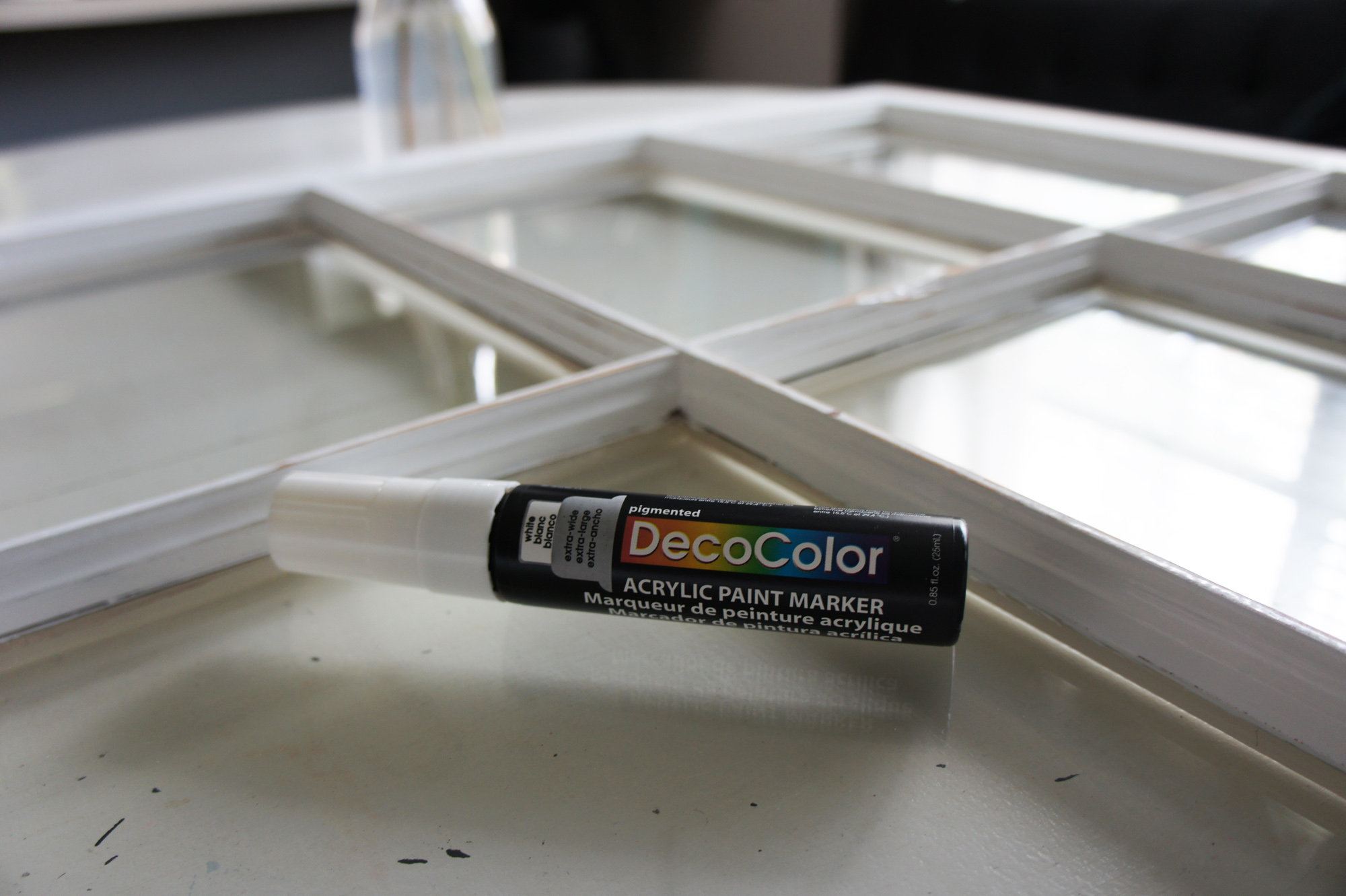 The supplies: an old window and this acrylic paint marker (I got this one at Hobby Lobby for $5)
