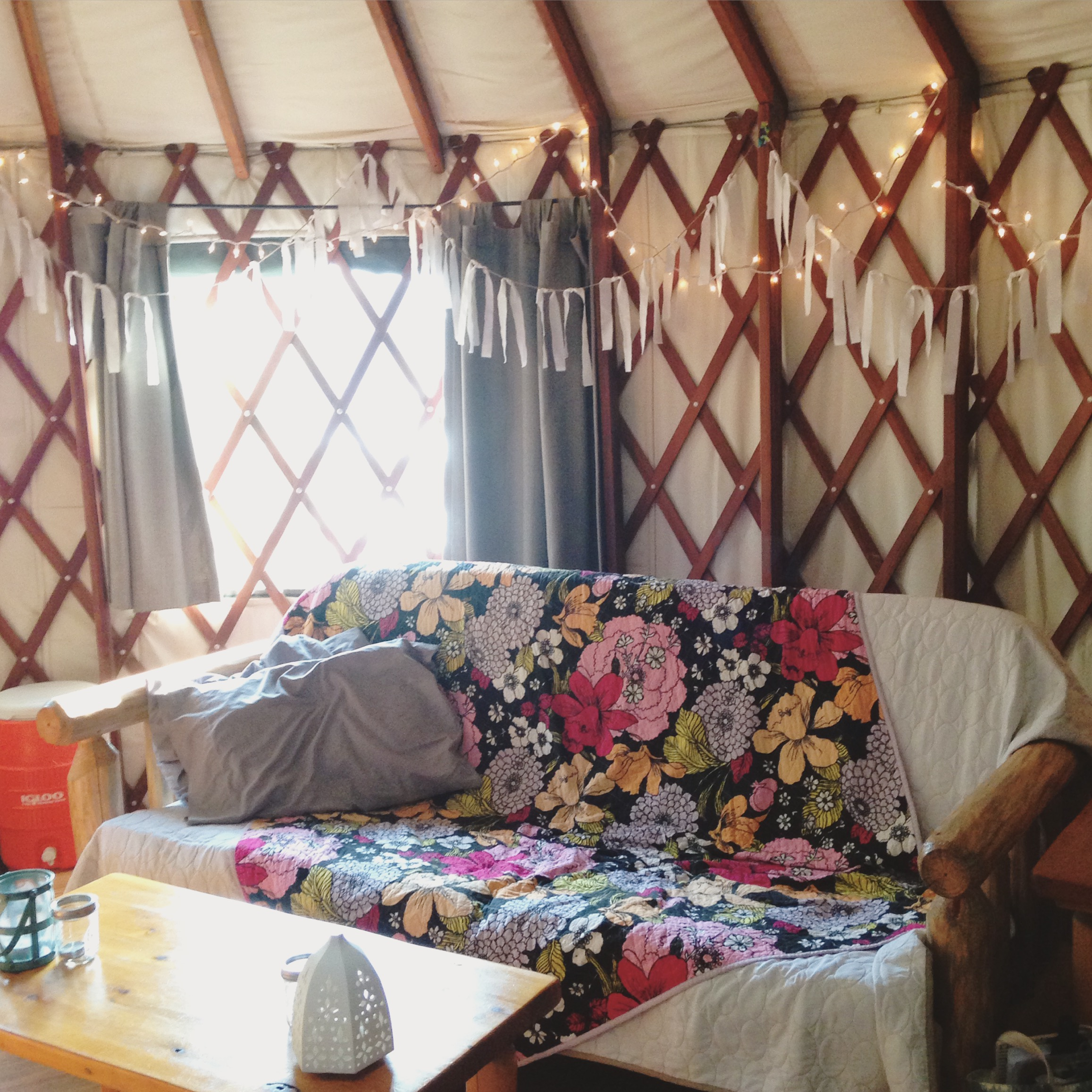 """Some twinkle lights, a bit of bunting, and some pretty quilts and candles are how we put the """"glam"""" in Glamping :)"""