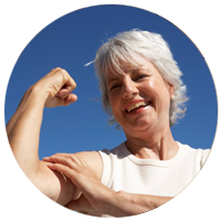Older woman with strong arms and bones. Jala Flow Yoga in Sidmouth can strengthen bones, preventing or delaying osteoporosis.