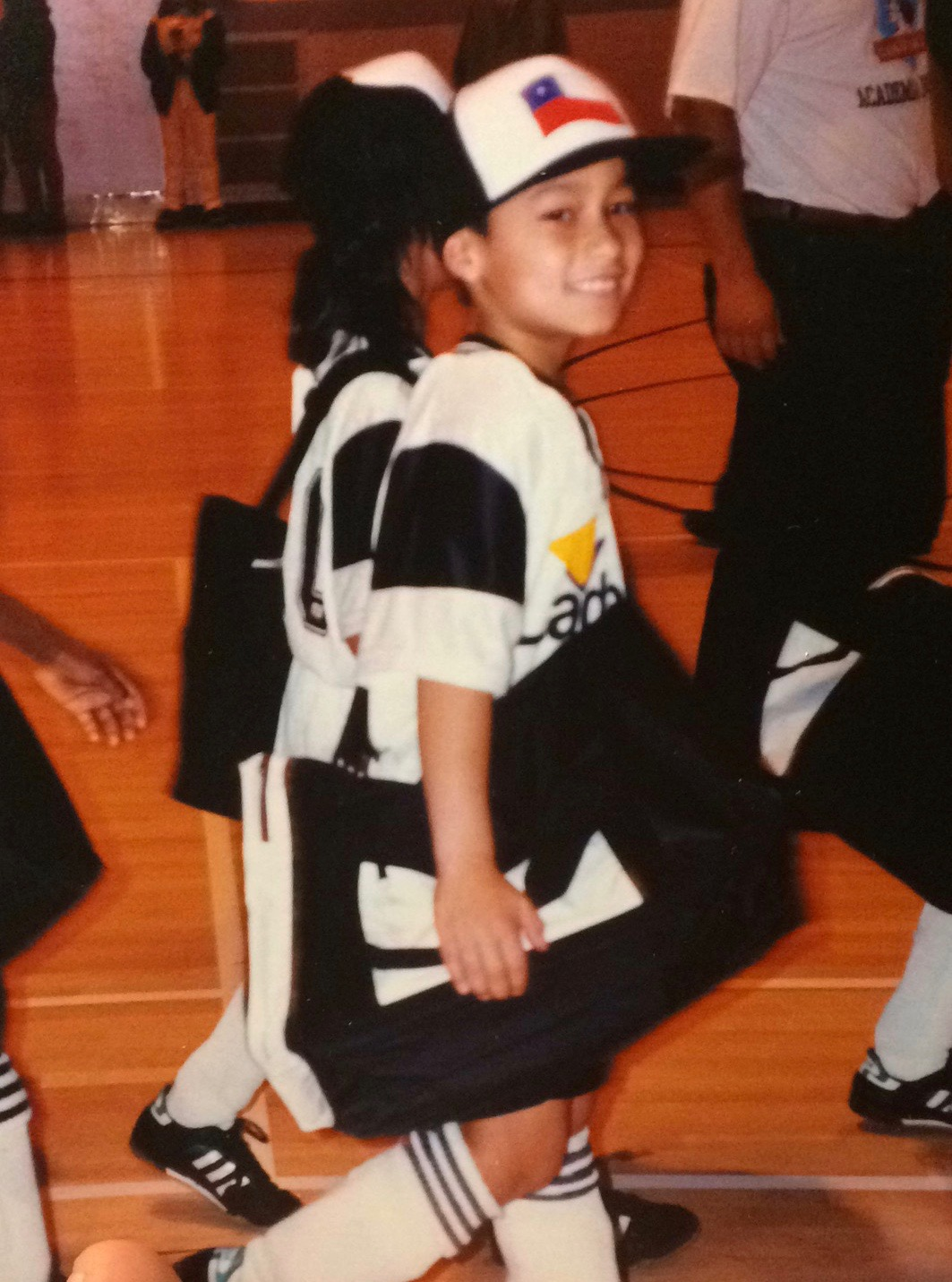 In my soccer uniform around 5-7 years old.