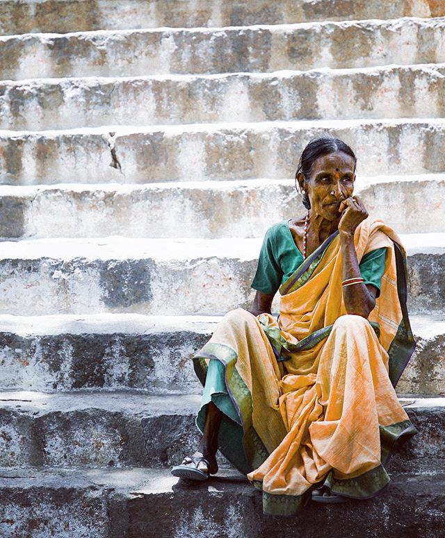 Woman on steps.  Golconda Fort, Hyderabad, India.