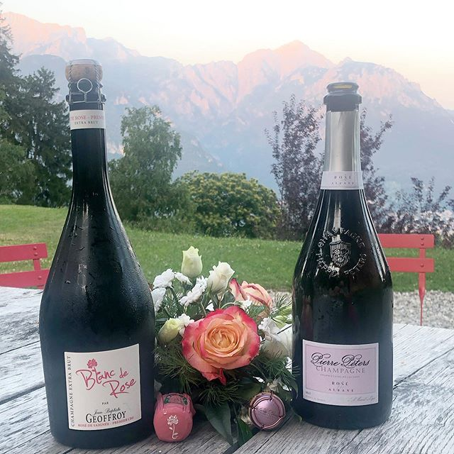 And on the 7th day...rosé. Two of the best - @champagnepeters Rosé for Albane and @champagnegeoffroy Blanc de Rose (which is for Karine, in fact). The Péters, a rosé d'assemblage, is a spectacular marriage of citrusy, mineral Le Mesnil Chardonnay with a saignée of Pinot from a village not too far away - 2 things that are fantastic alone but even greater together. Jean-Baptiste's version is a unique co-maceration of Pinot Noir and Chardonnay (50/50), giving it a full range of fruity and floral notes, and tempering the strength of the Cumières Pinot in a very balanced way. As I poured that one and saw the brilliant way the color radiated from the glass, reminiscent of his more widely known Rosé de Saignée, I decided next time I'm fortunate enough to have these wines together, the Saignée needs to be a part of it as well (for research purposes of course). The observant drinker might make the connections between the three.... Merci, Rodolphe et J-B!  #champagne #roséchampagne #lemesnil #cumières #chardonnay #pinotnoir #ensemble #teamwork  #growerchampagne #bubblyothèqueandfriends #vacances