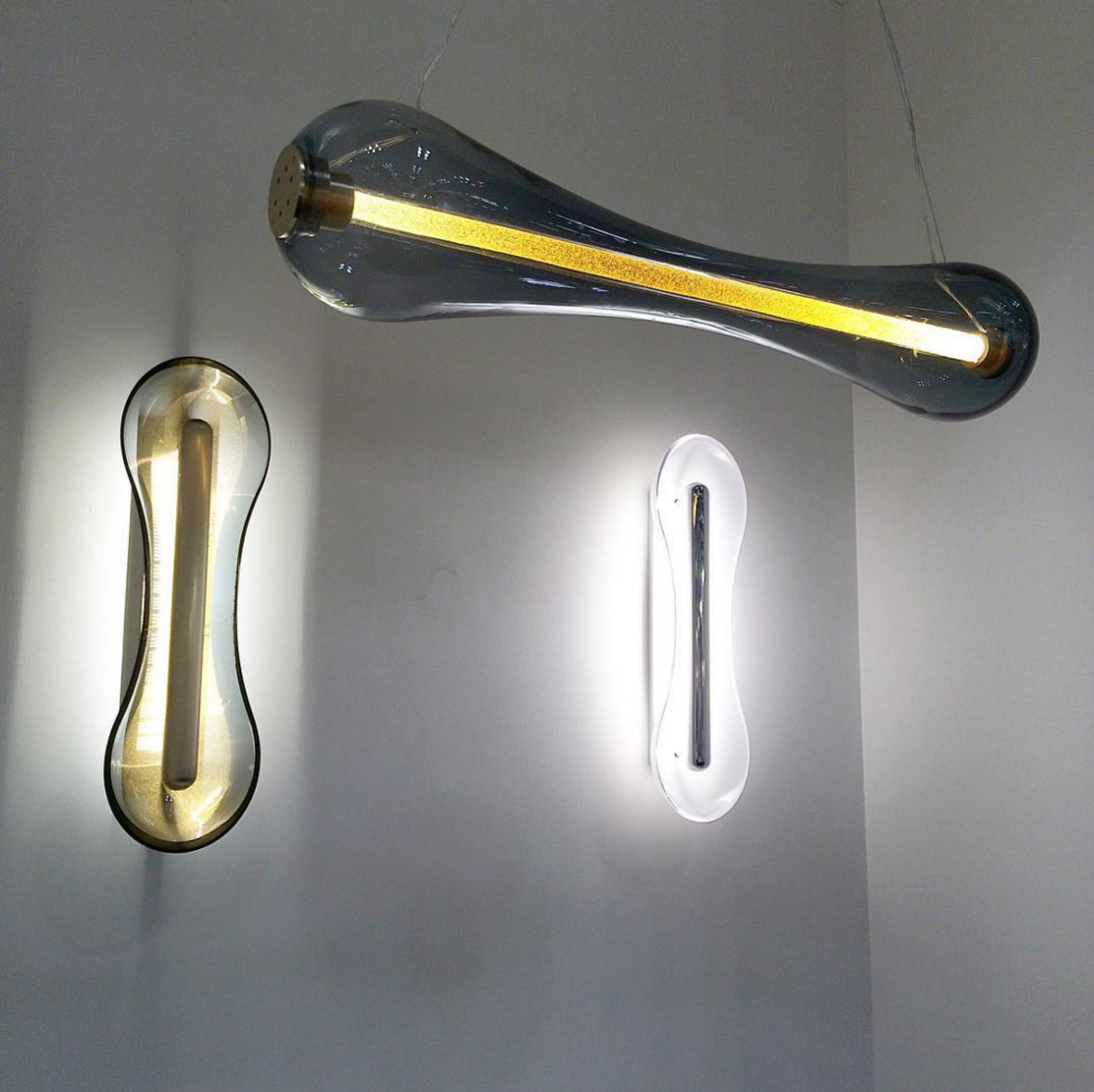 "Patrick Naggar's ""Cell"" pendant and sconces at ICFF in gold leaf glass"