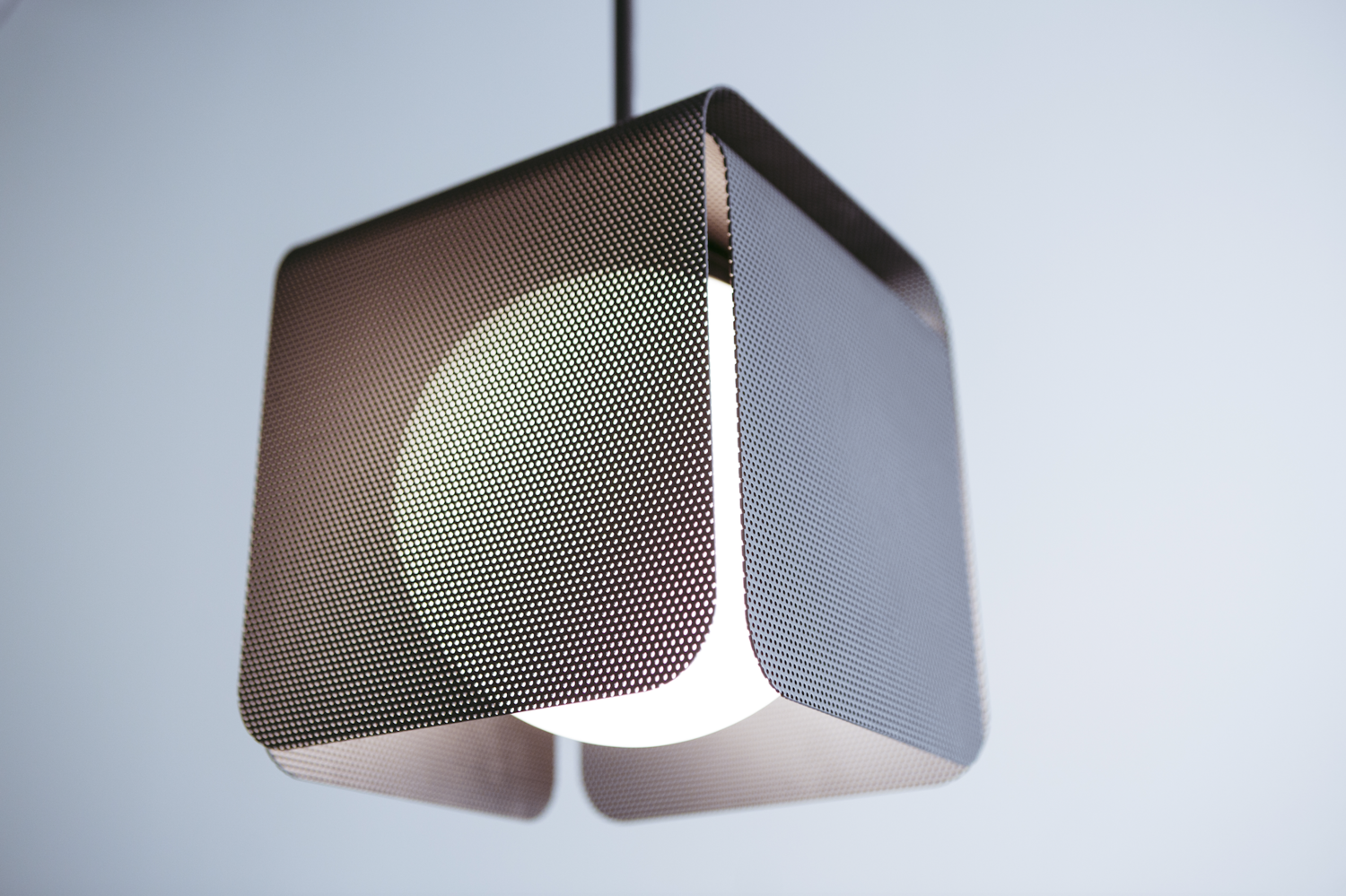 "Tomnuk's new ""Veil"" sconce and pendant at WantedDesign with perforated metal"