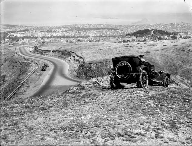 View from Twin Peaks (Eureka Peak) looking north, 1923c. Photo for a car ad. Image from original glass negative.
